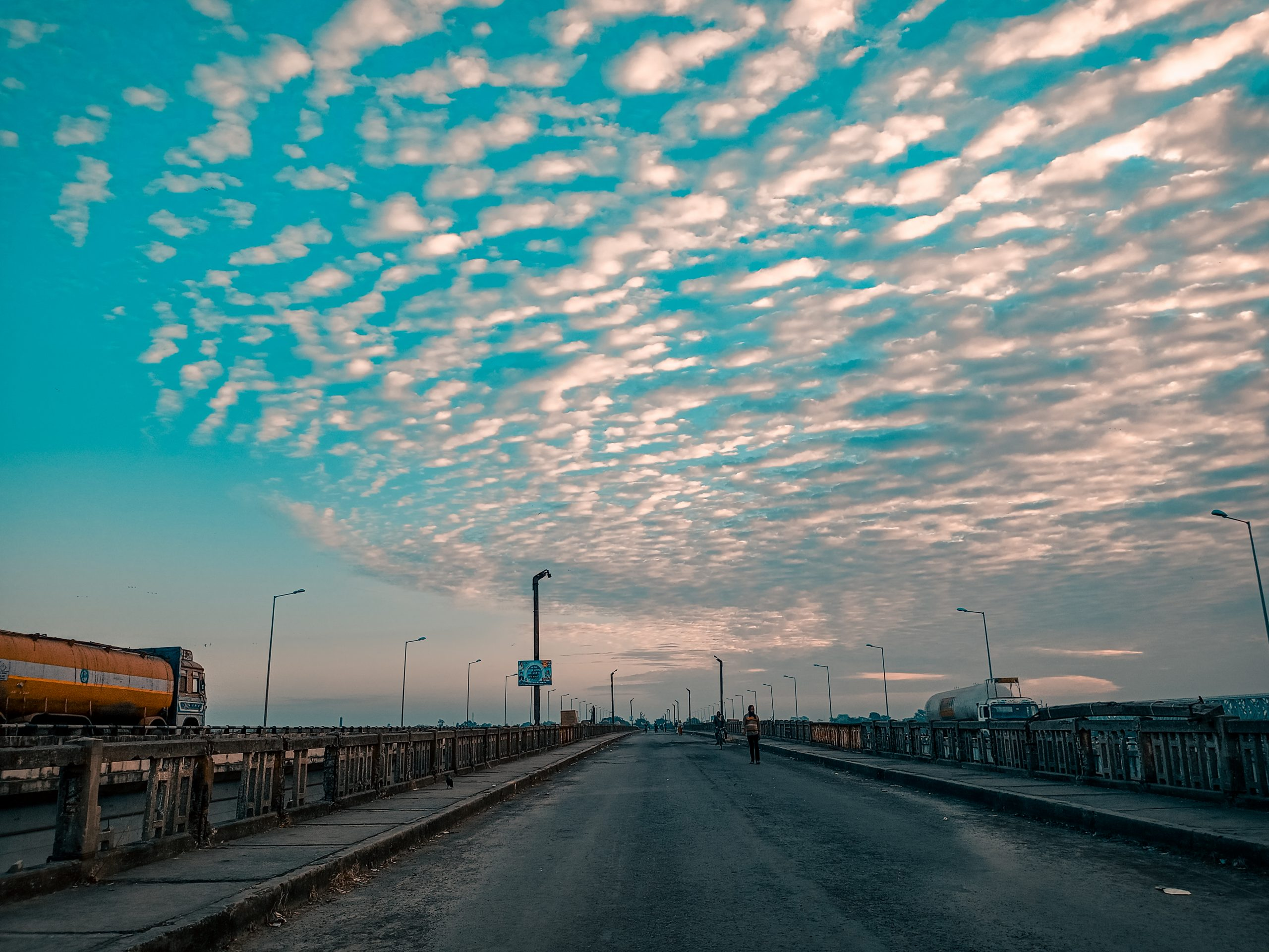 Snap of a highway with fascinating clouds