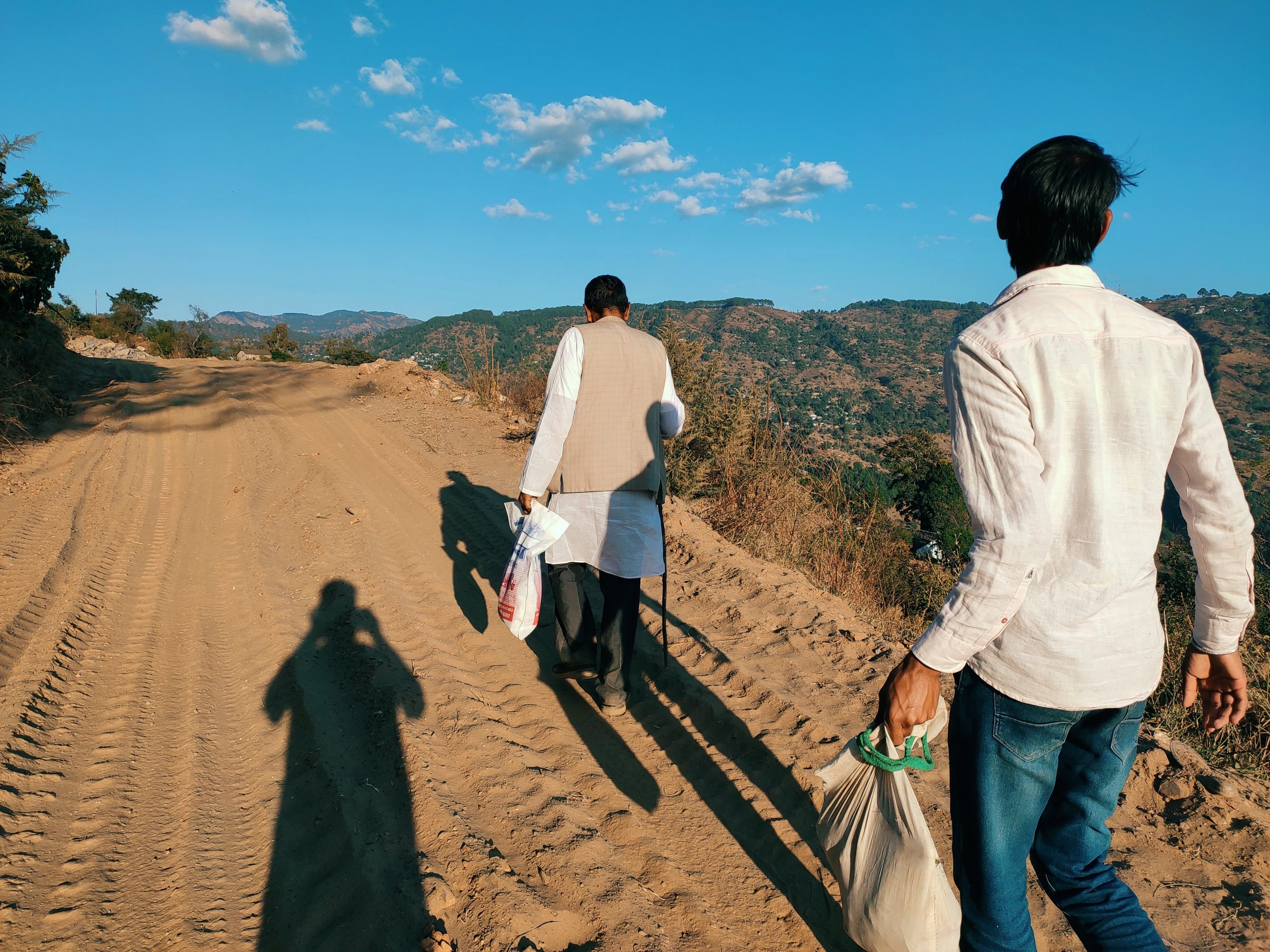 A village men walking on dirt road
