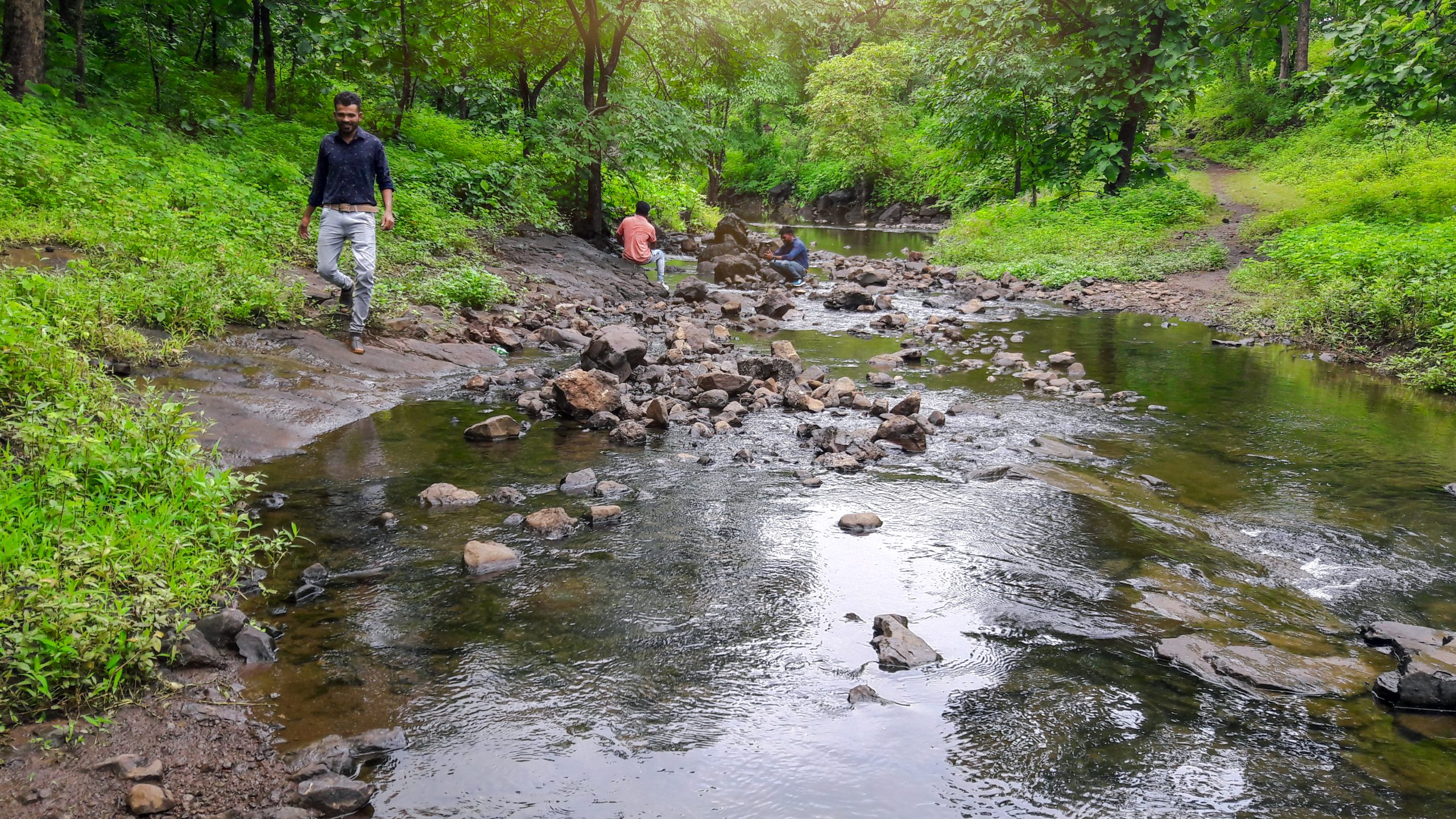 People enjoying in jungle near the river