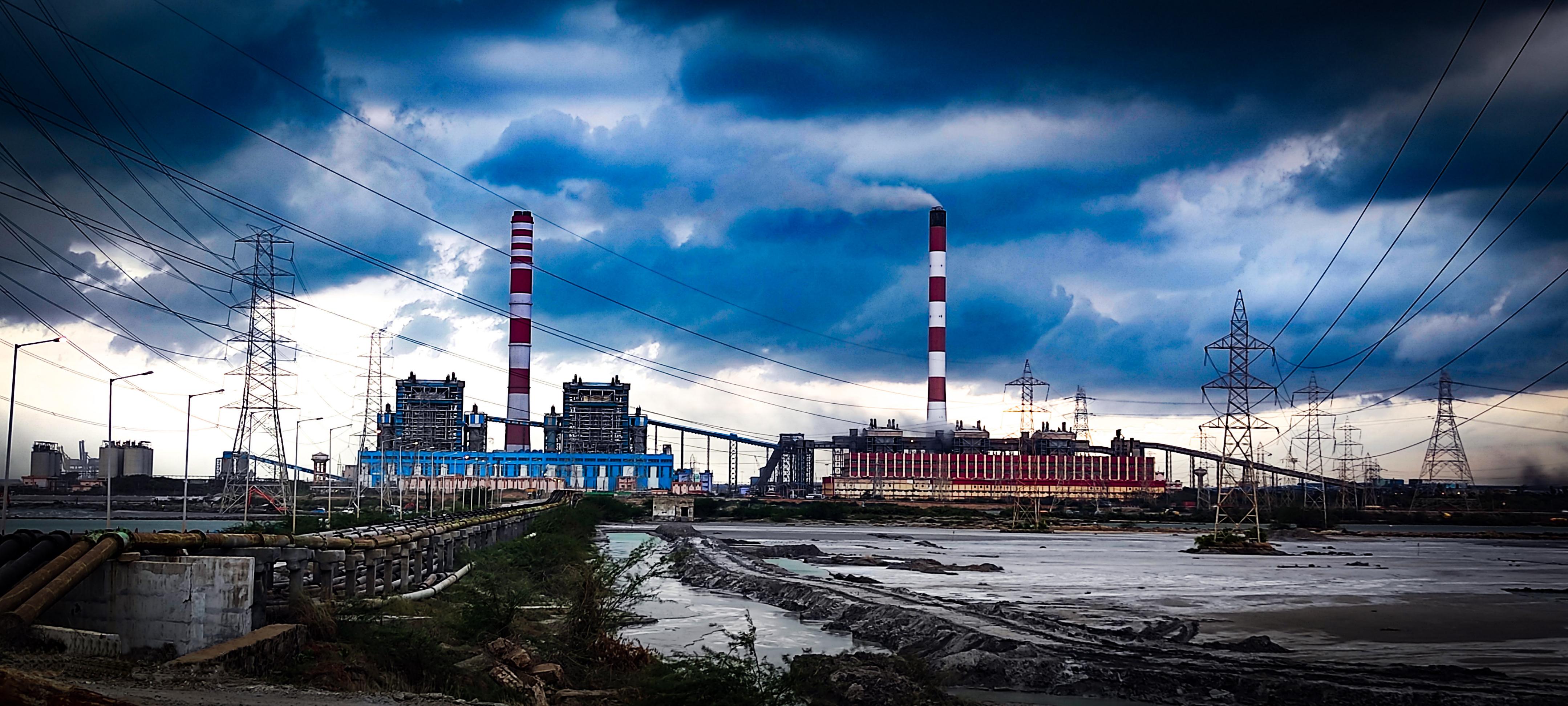 Factory under dark clouds