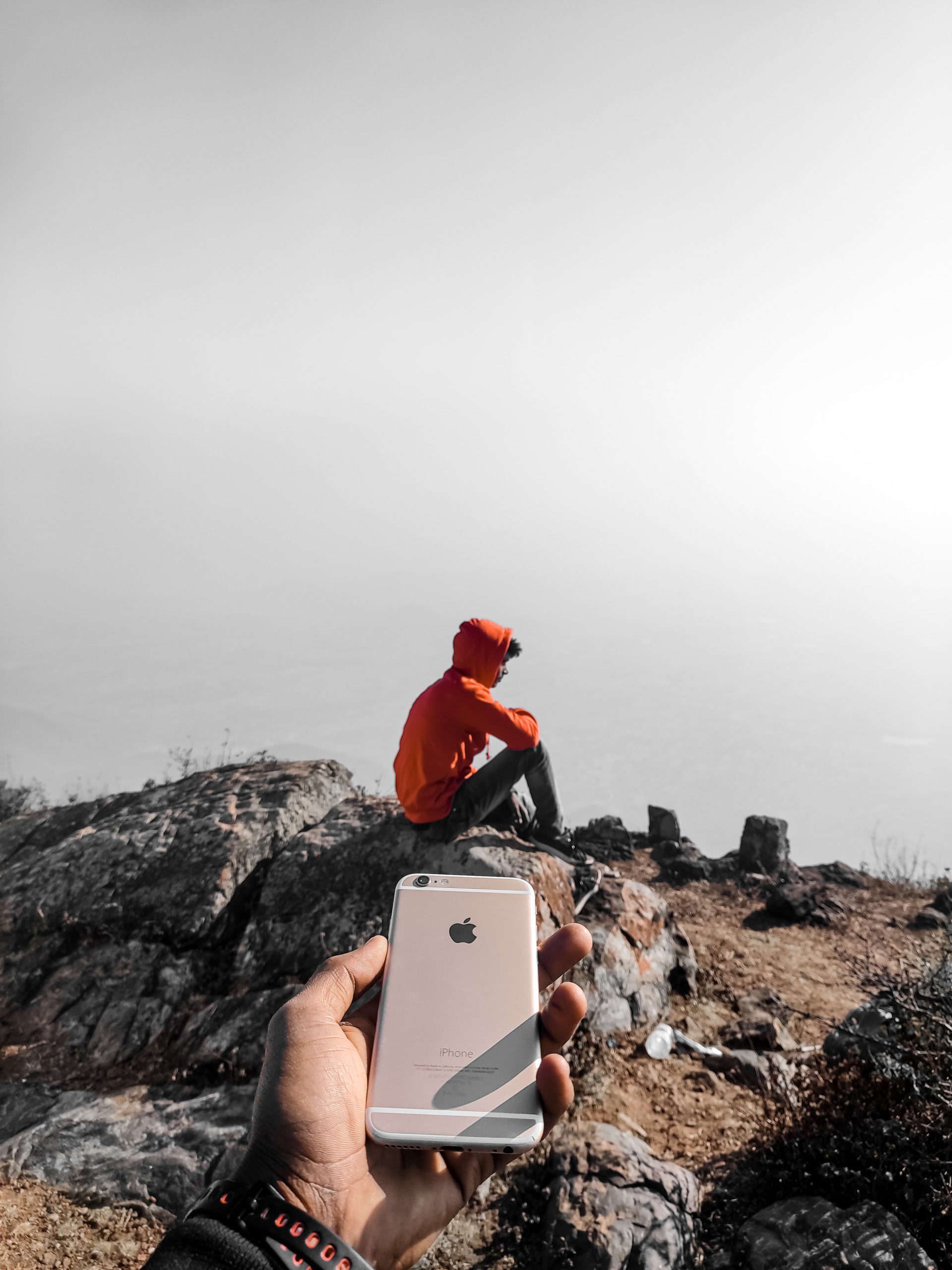 Pointing phone to a boy on hills