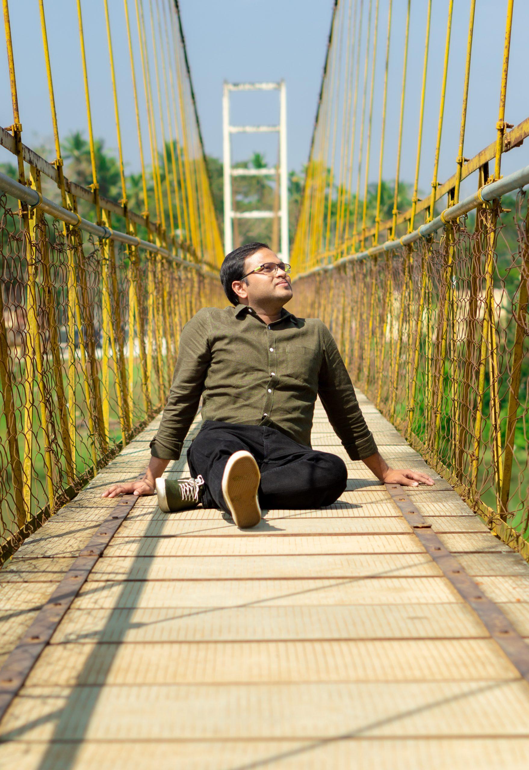 Boy posing on hanging bridge