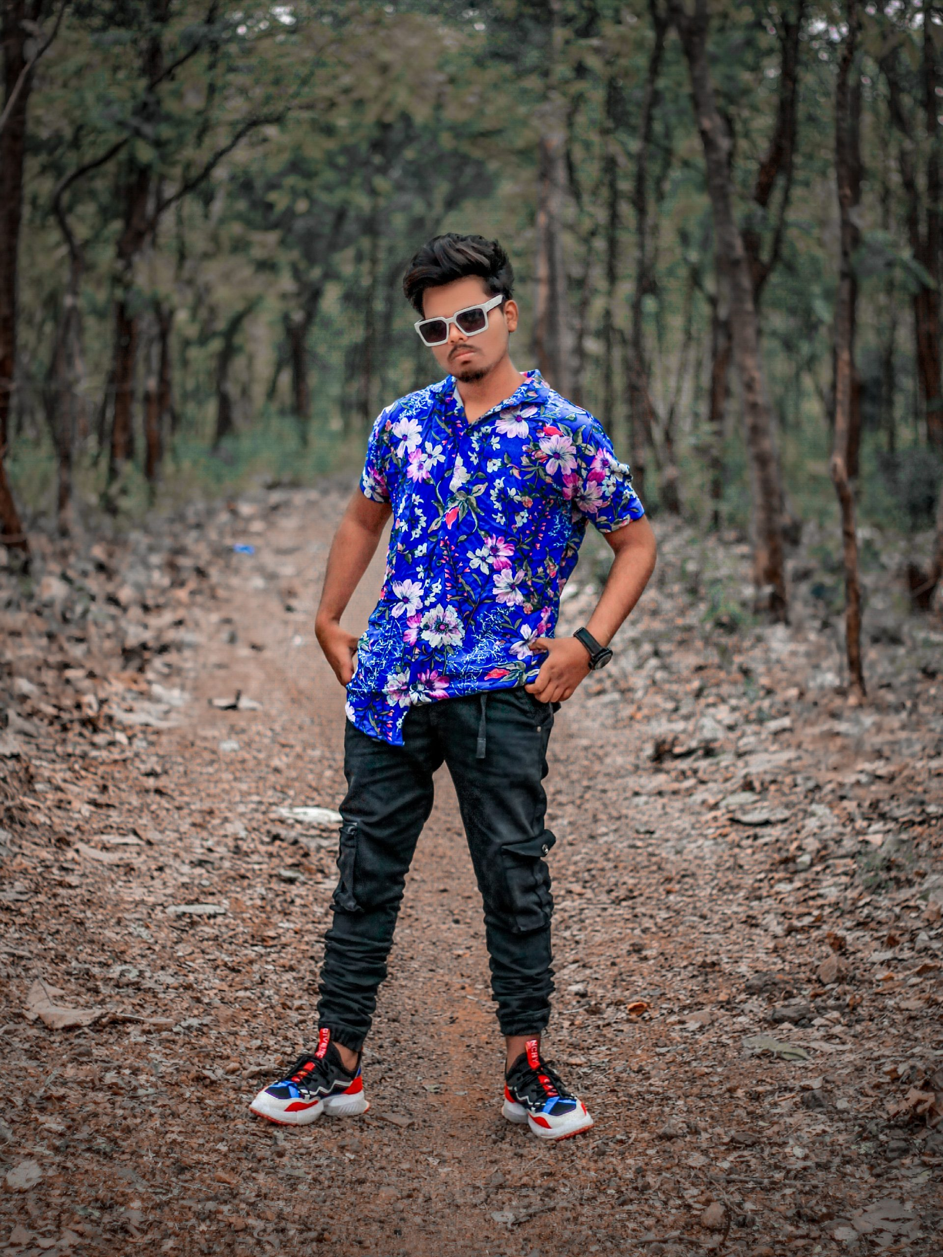 Boy posing in forest