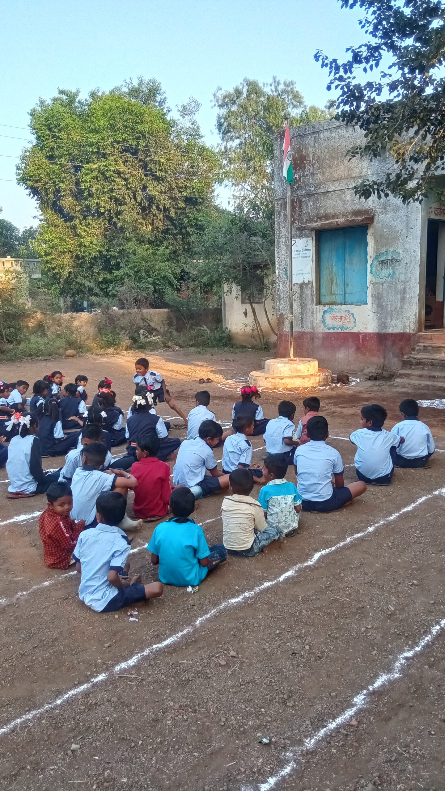 School students sitting on the ground