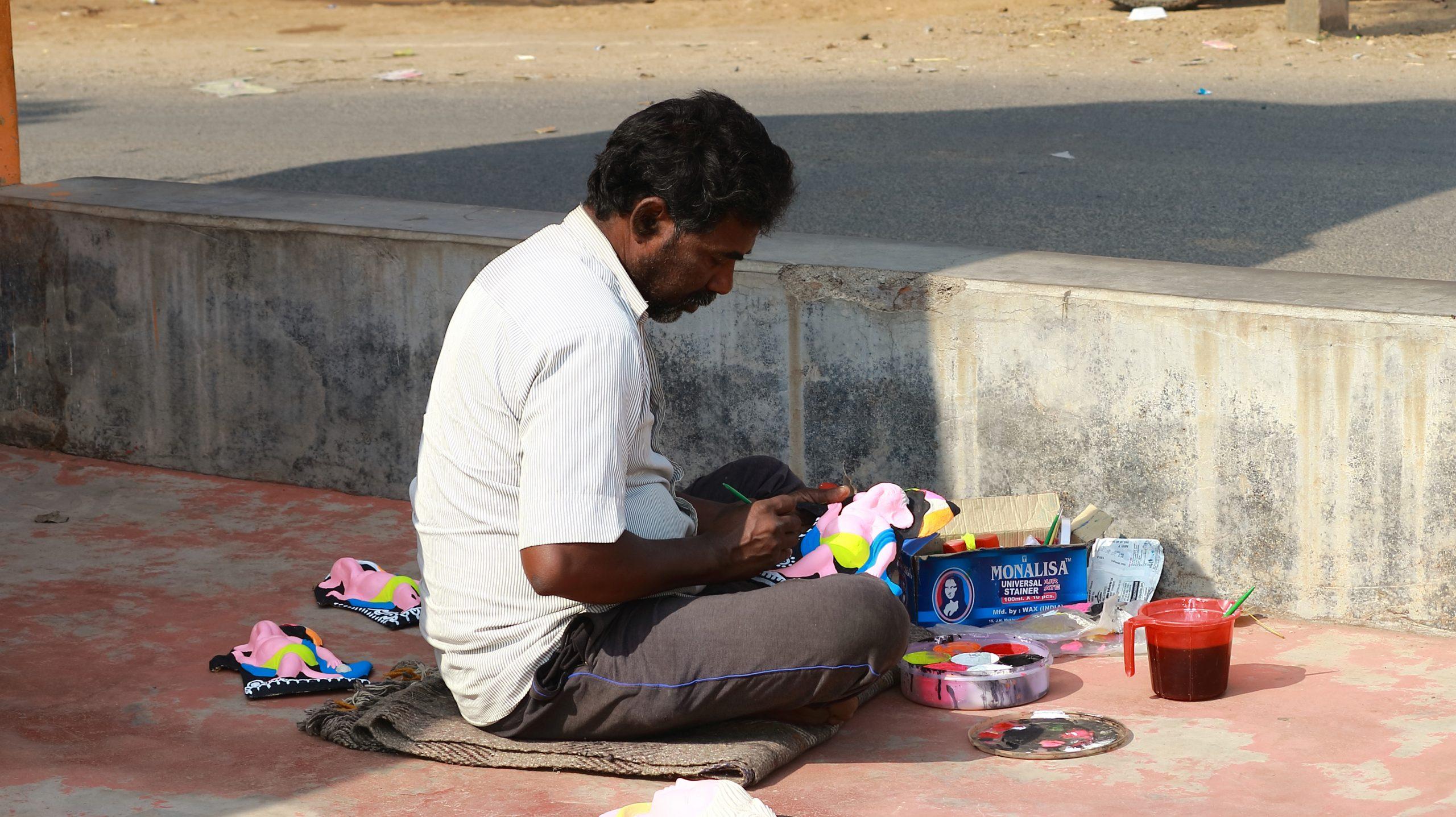 Artist sitting roadside
