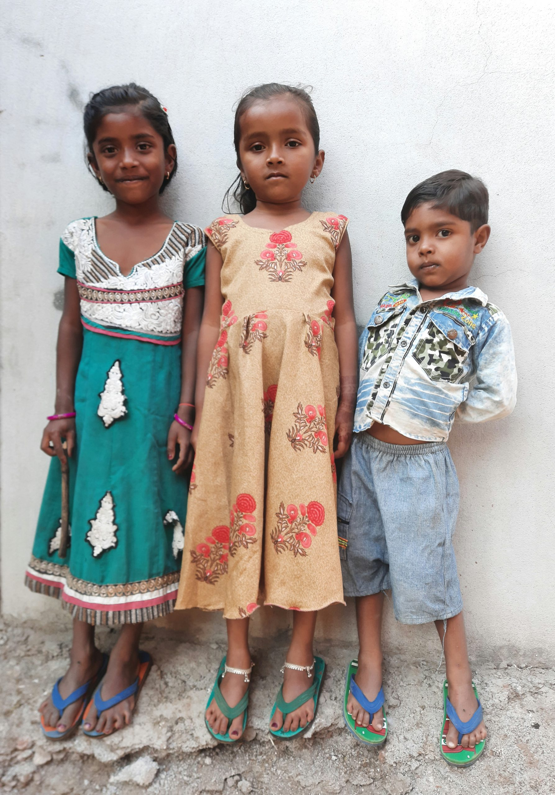 Kids posing against the wall