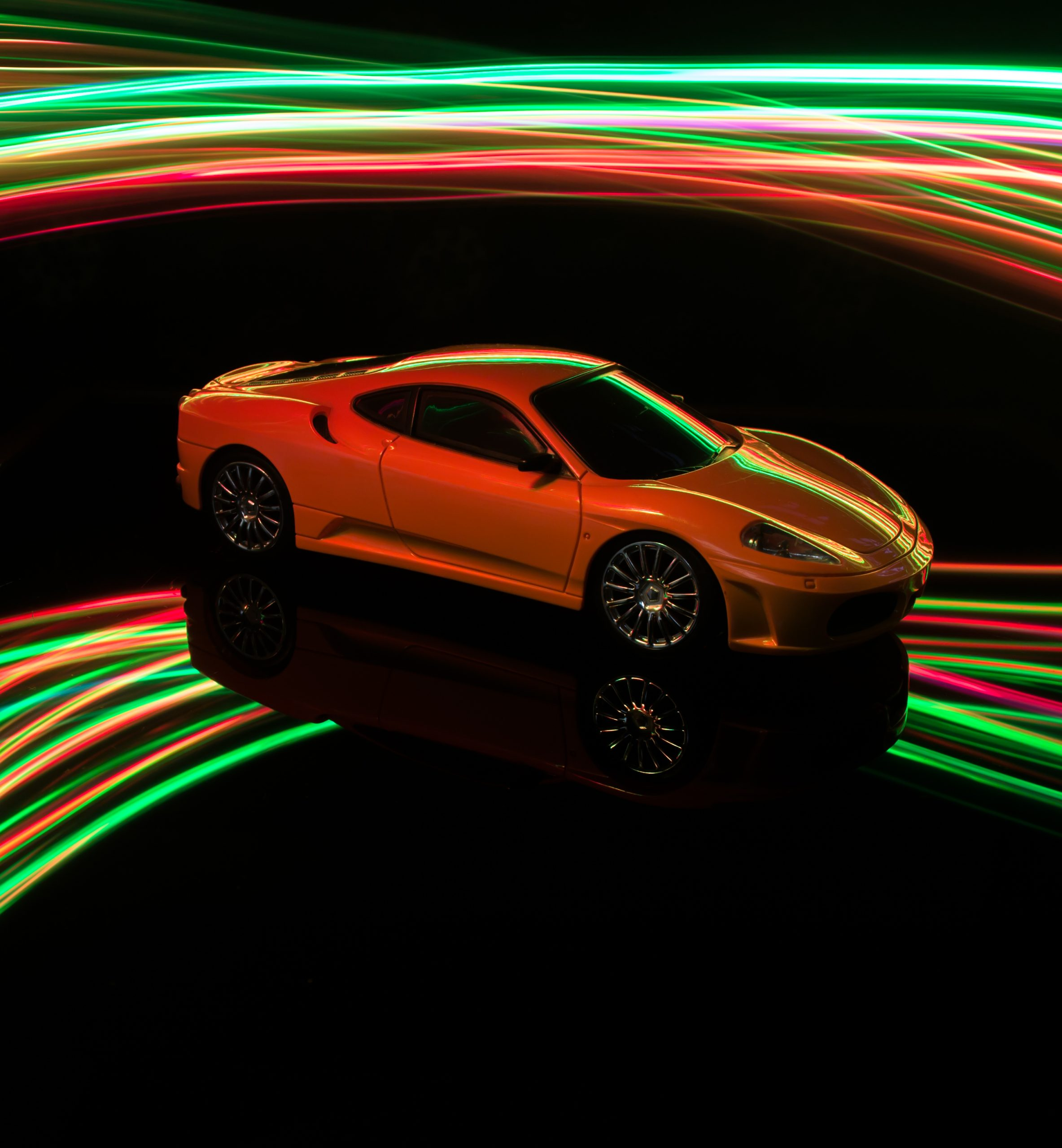 Toy car with lighting in background