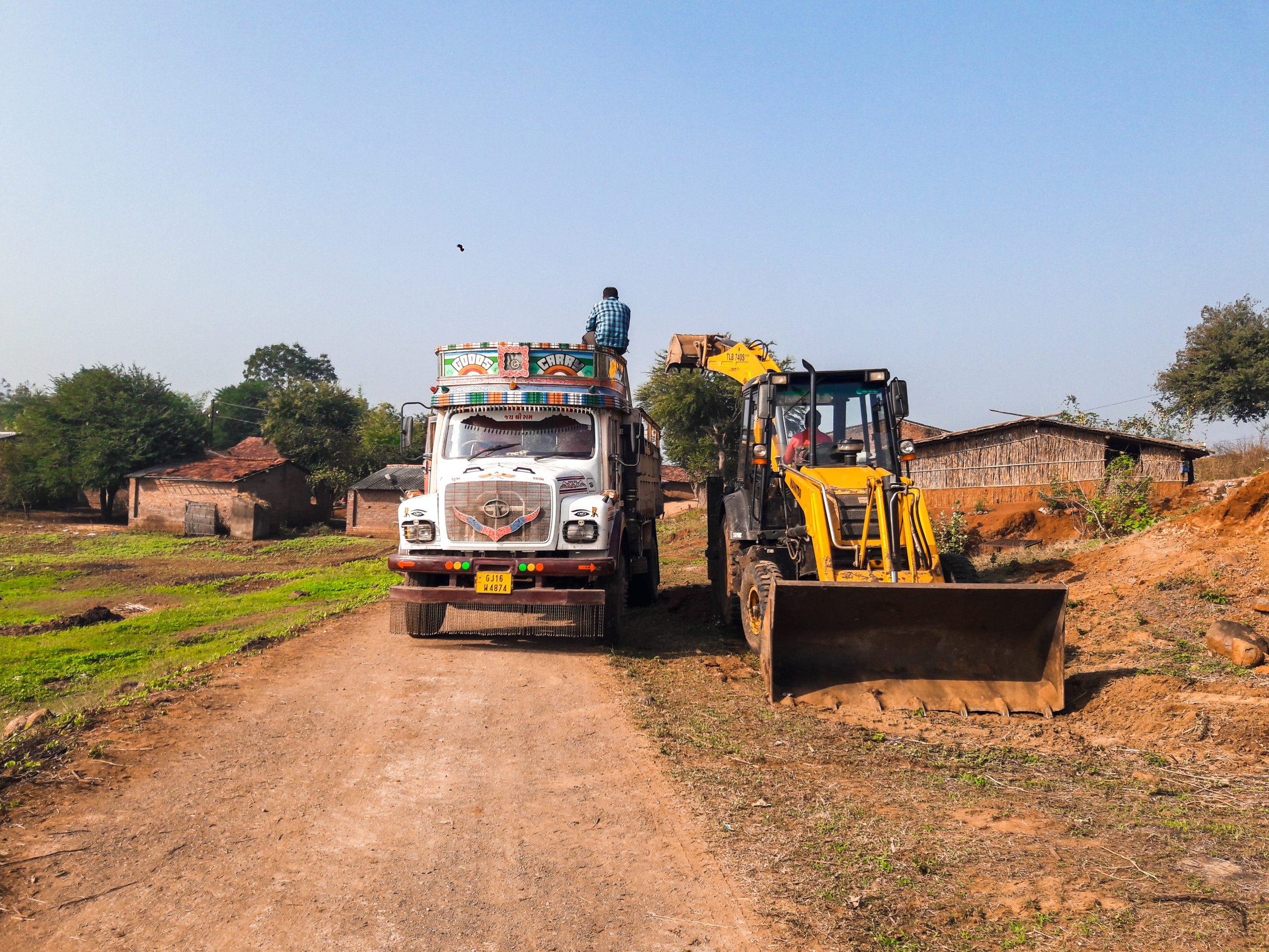 Truck and bulldozer at the farm
