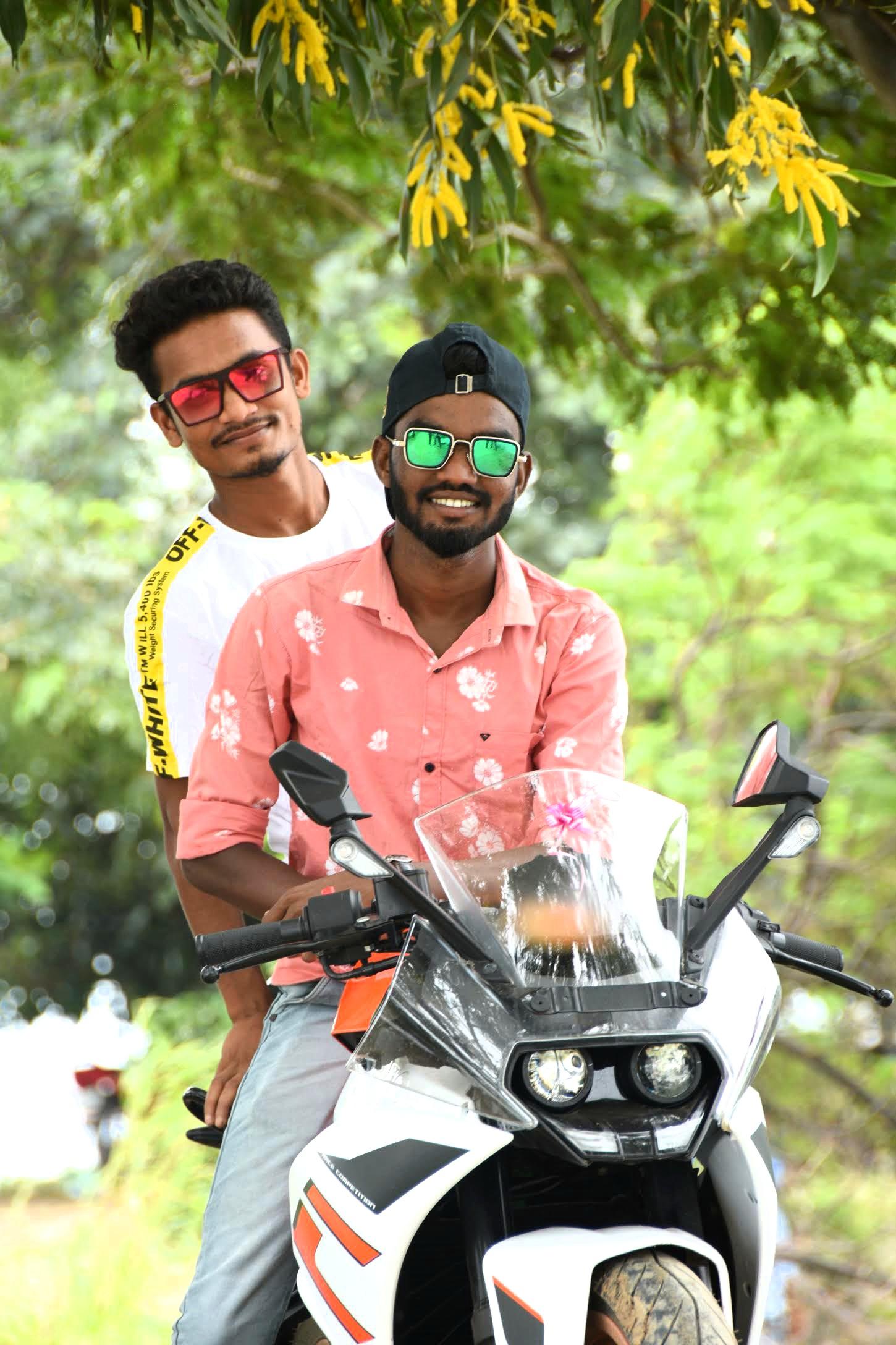 Two boys posing on bike