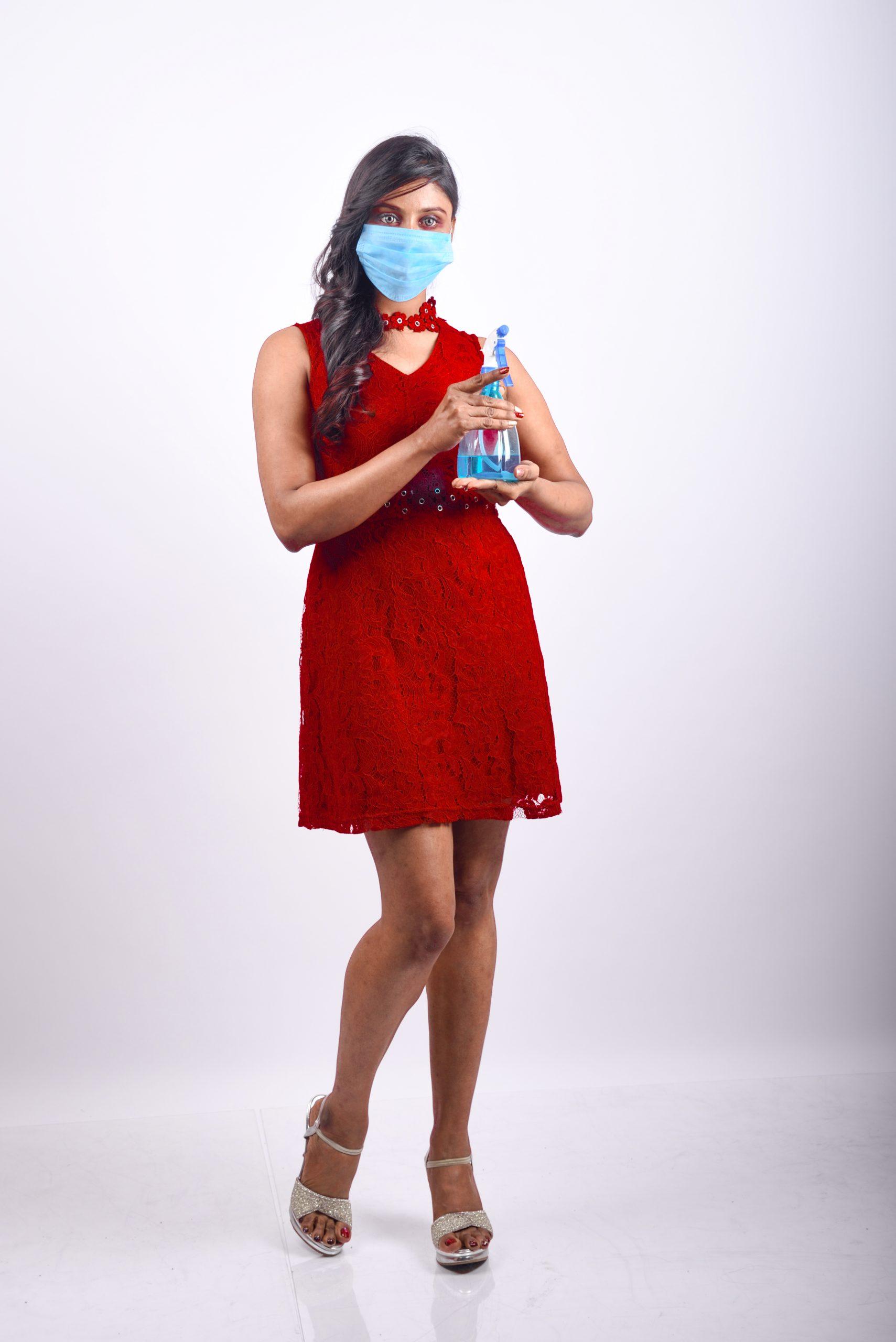 Model displaying hand sanitizer