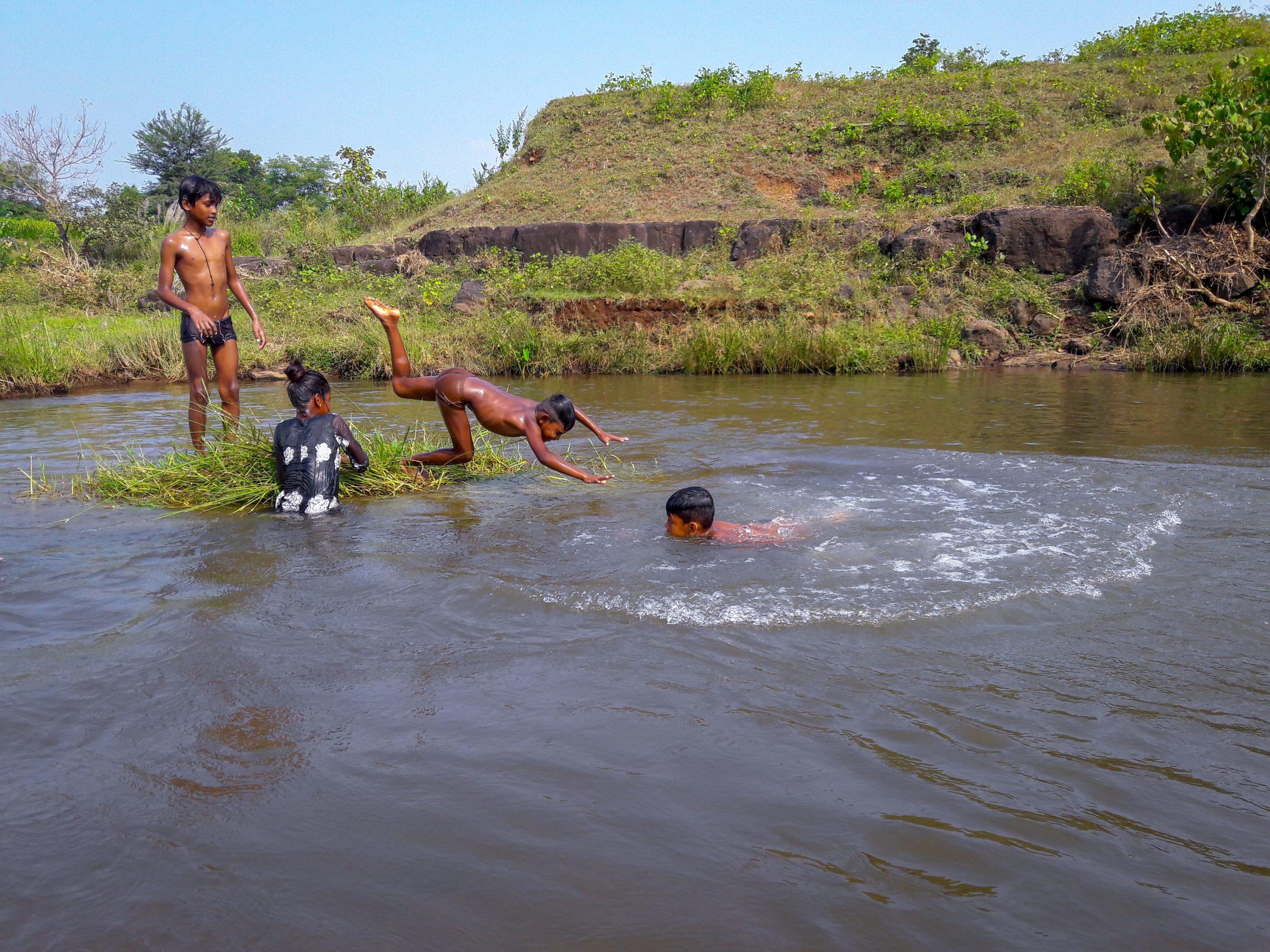 A village children swimming in a river