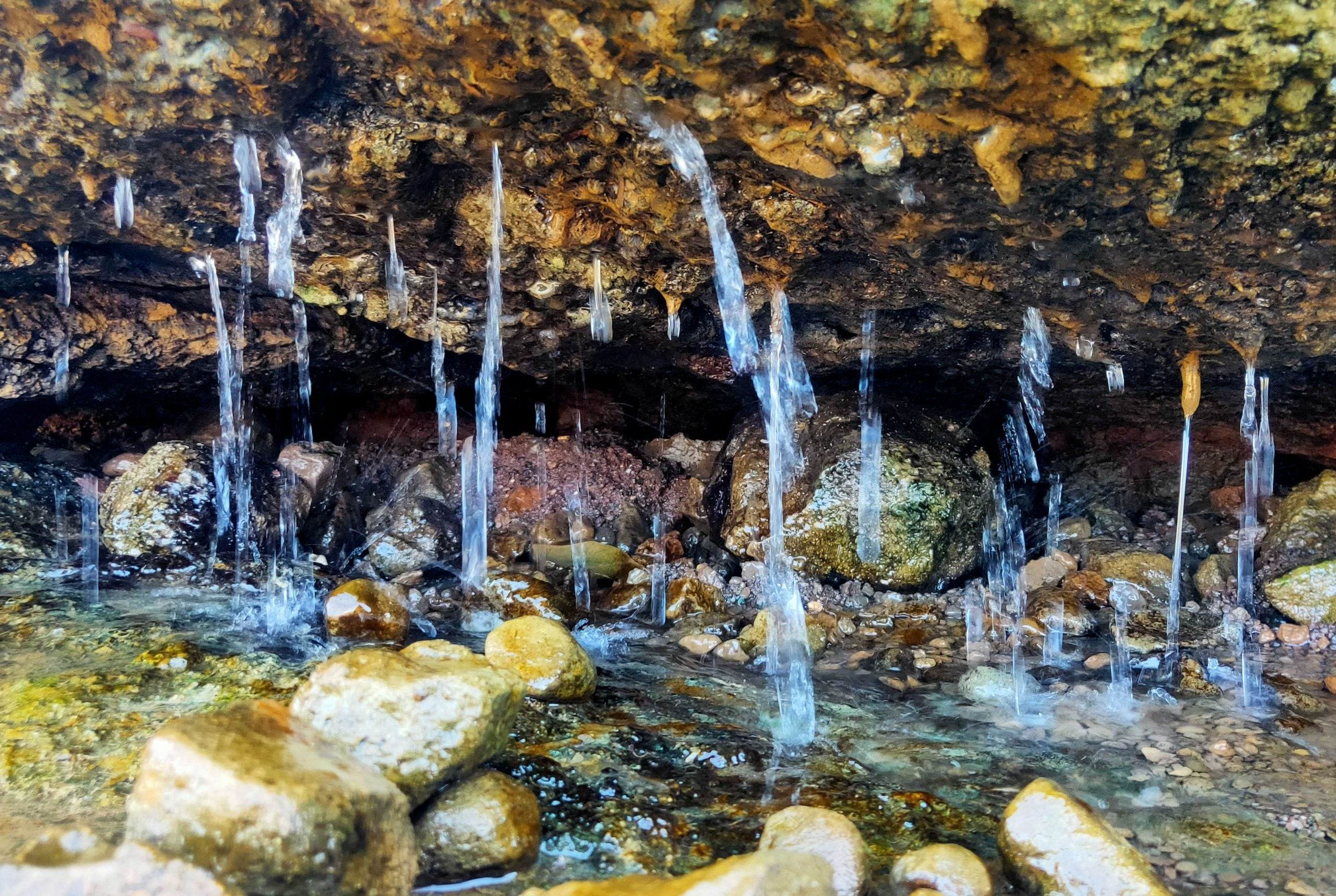 Water droping from a rocky cave
