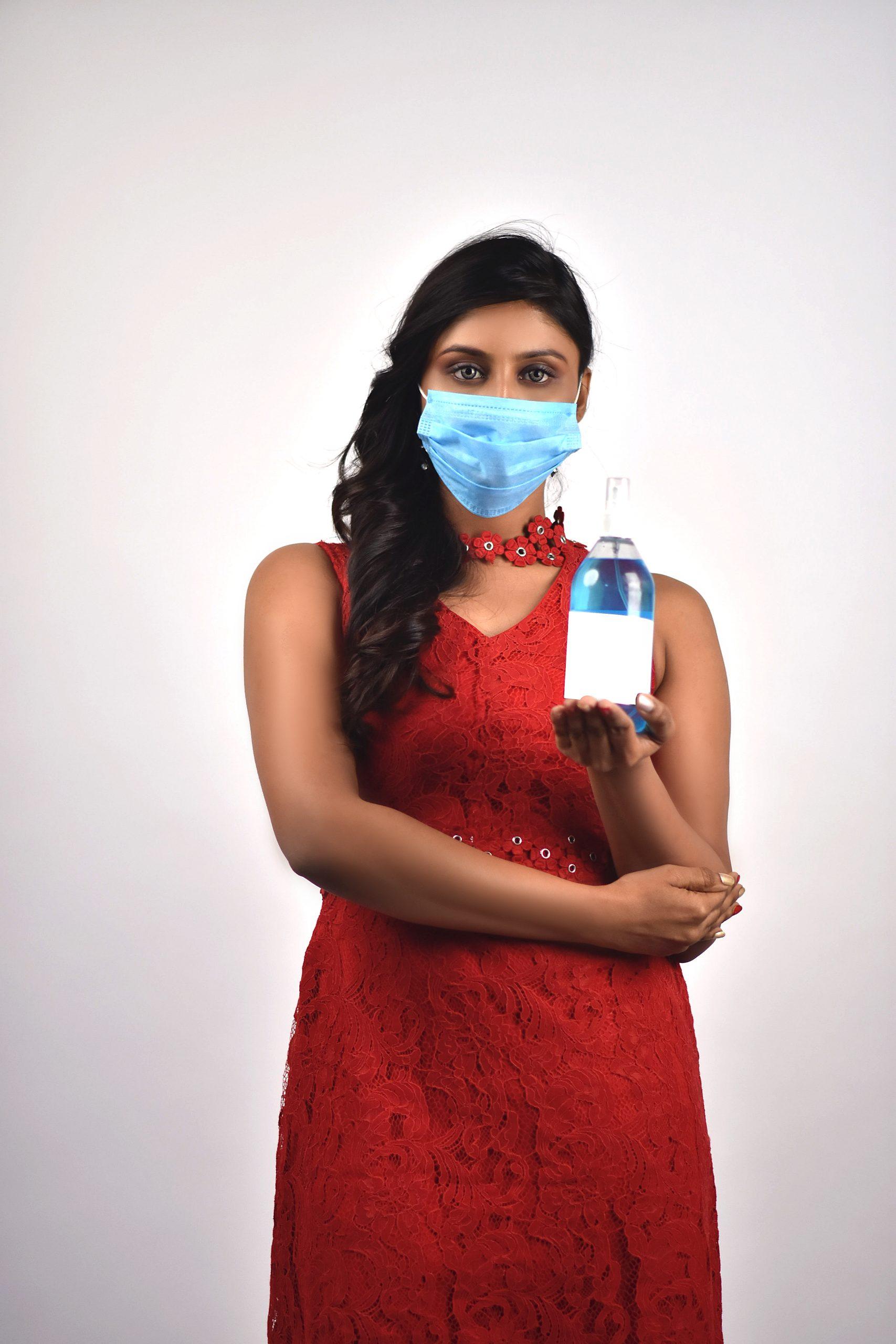 Woman displaying sanitizer