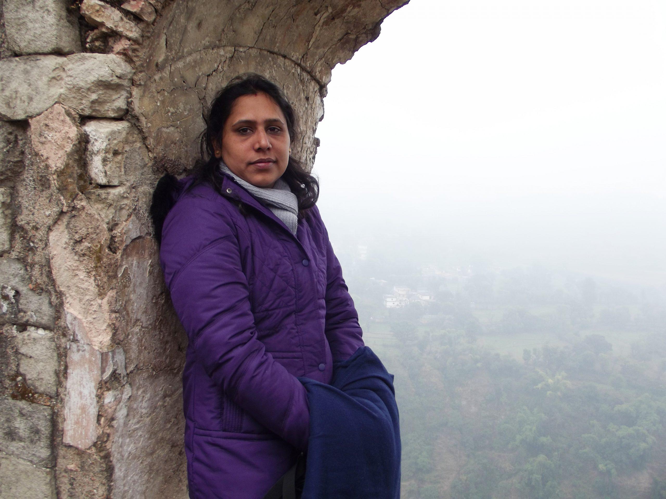 Woman posing near the wall