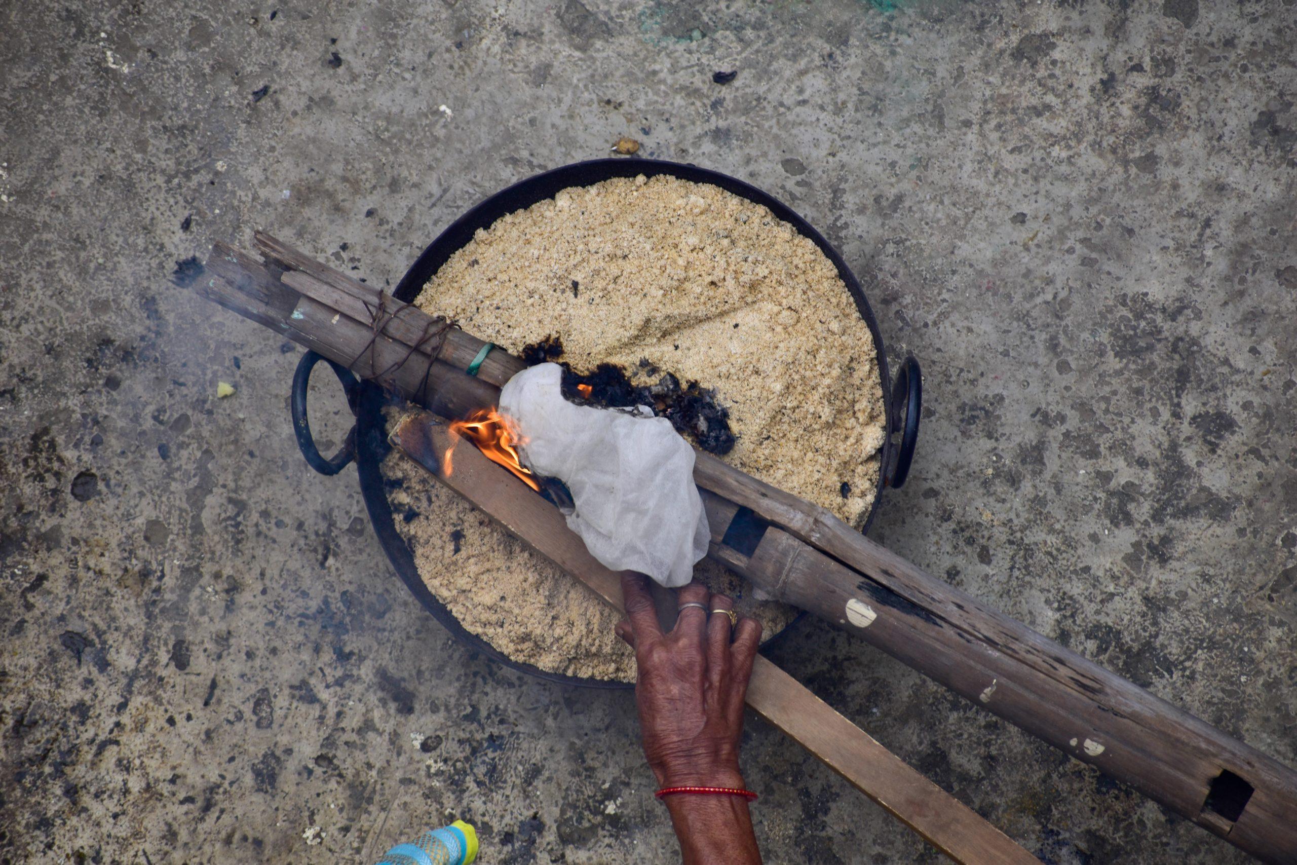 Burning wood in vessel