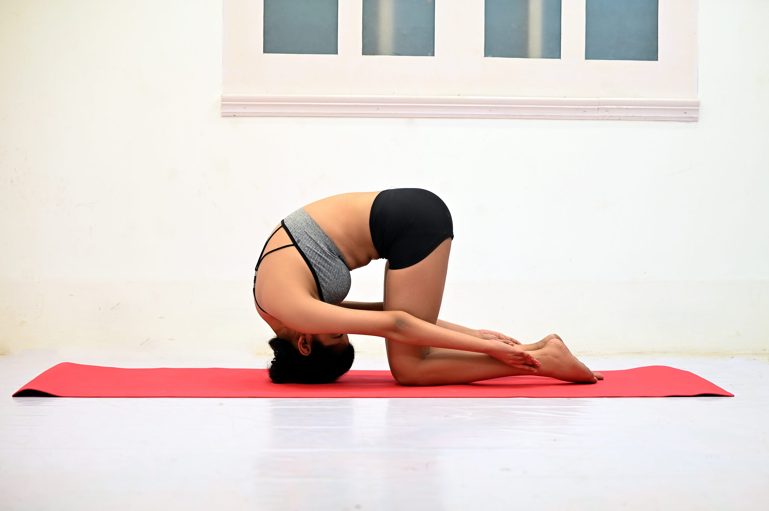 Girl doing Yoga on yoga mat