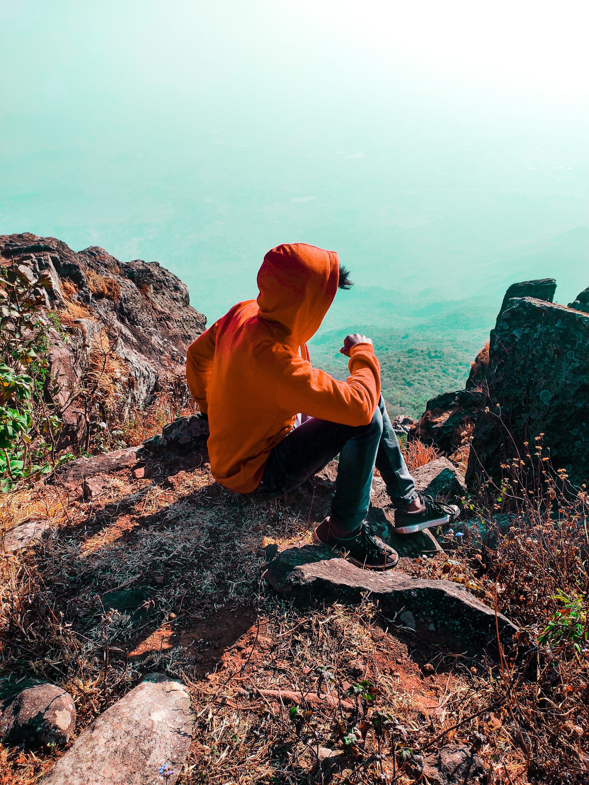Boy posing in mountains