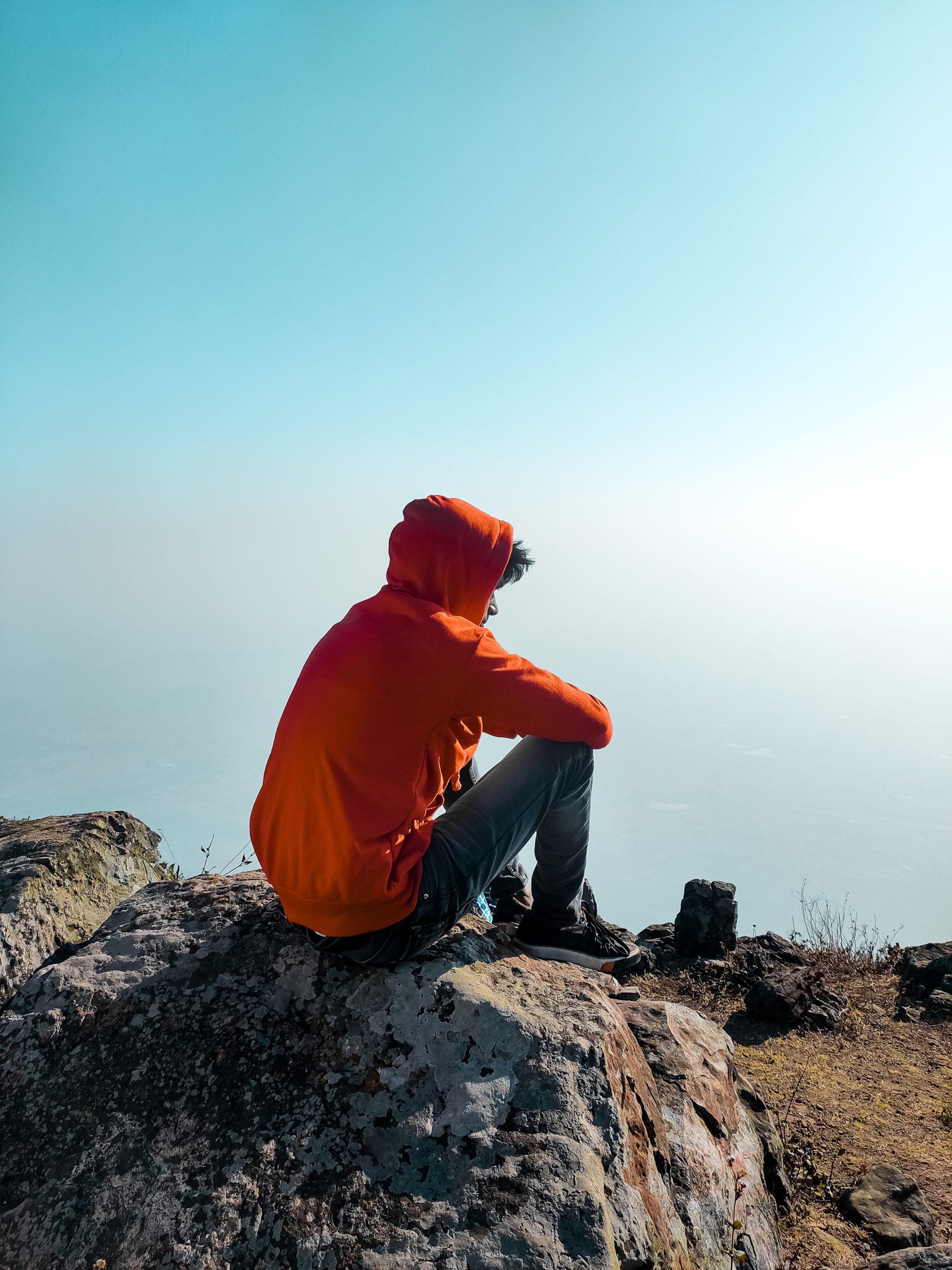 A sad boy on a rock