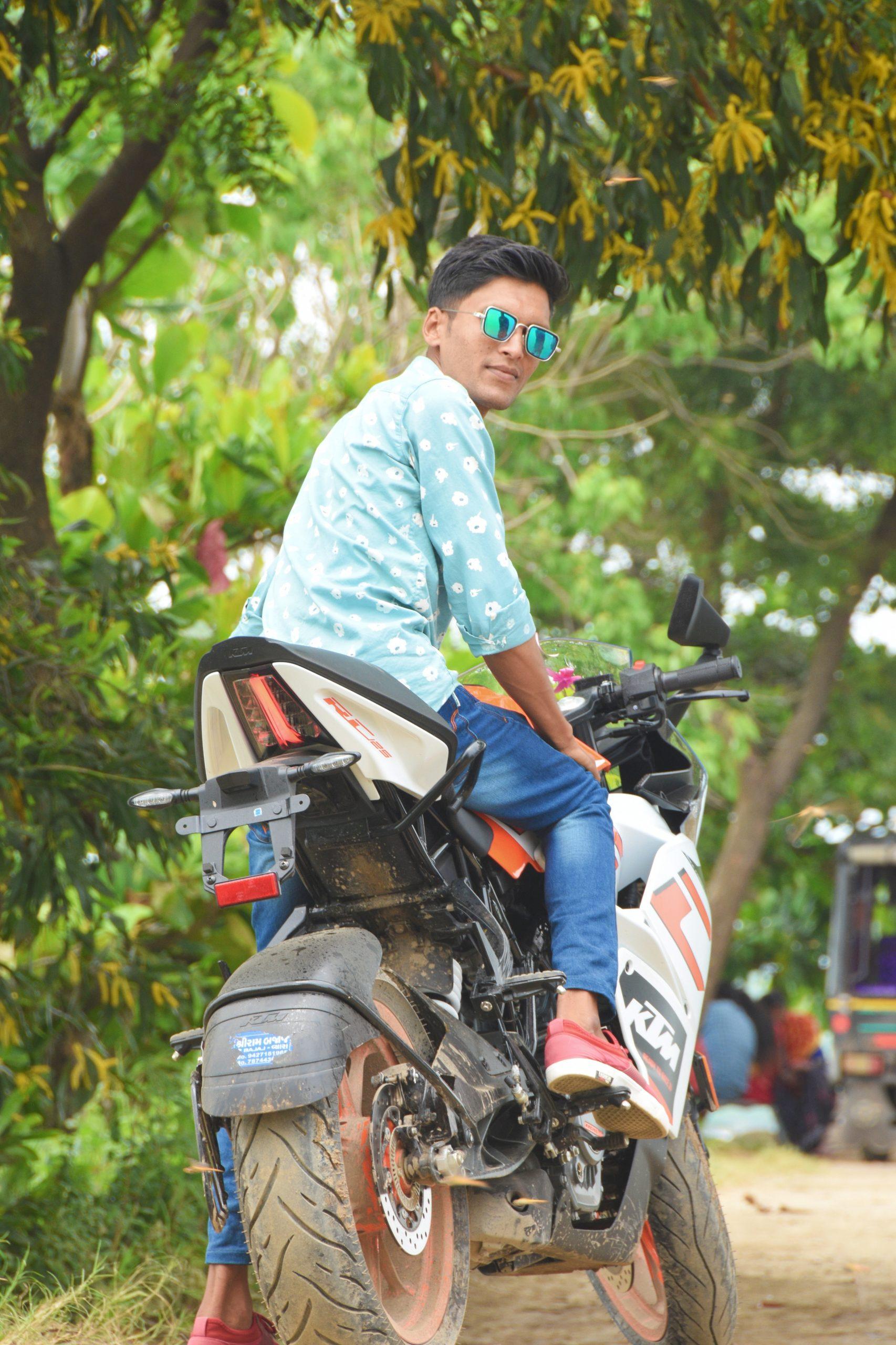 boy posing on a bike