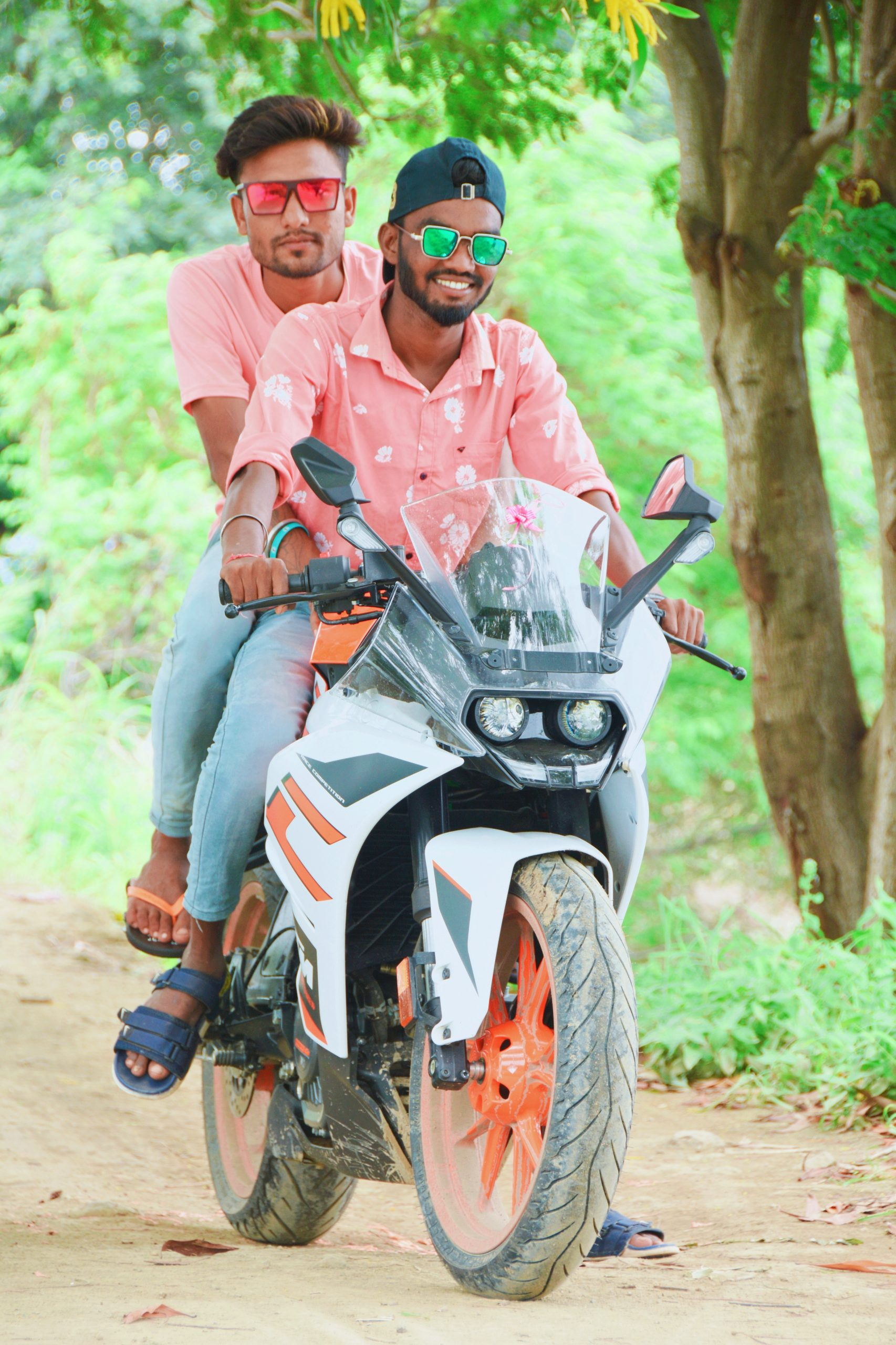 Boys posing on KTM bike