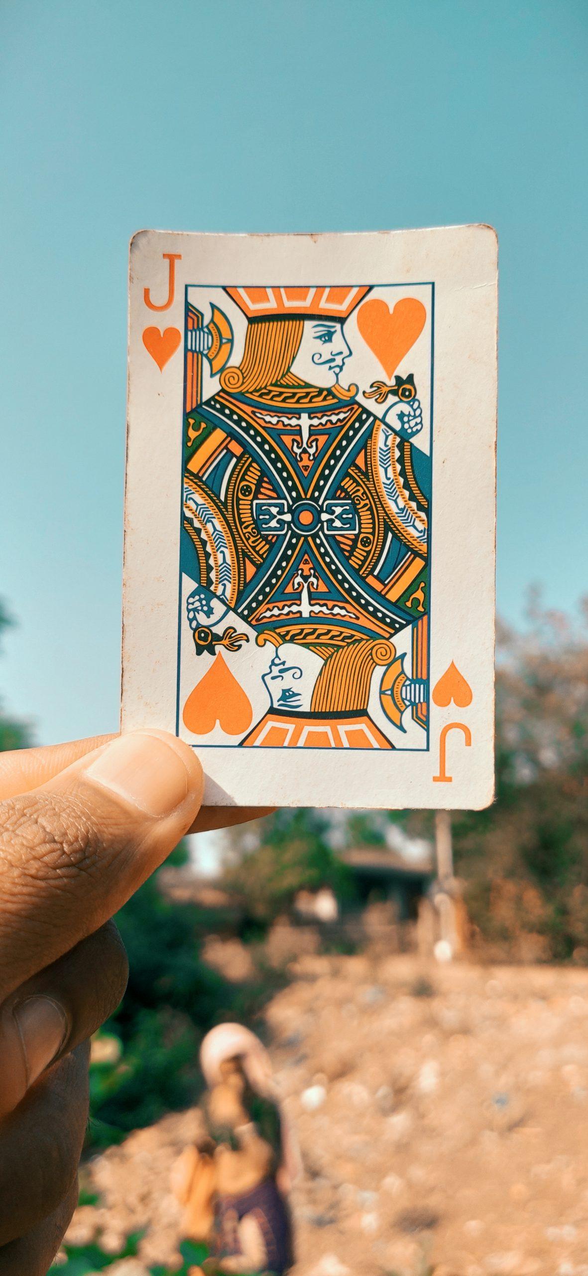 Joker card in hand