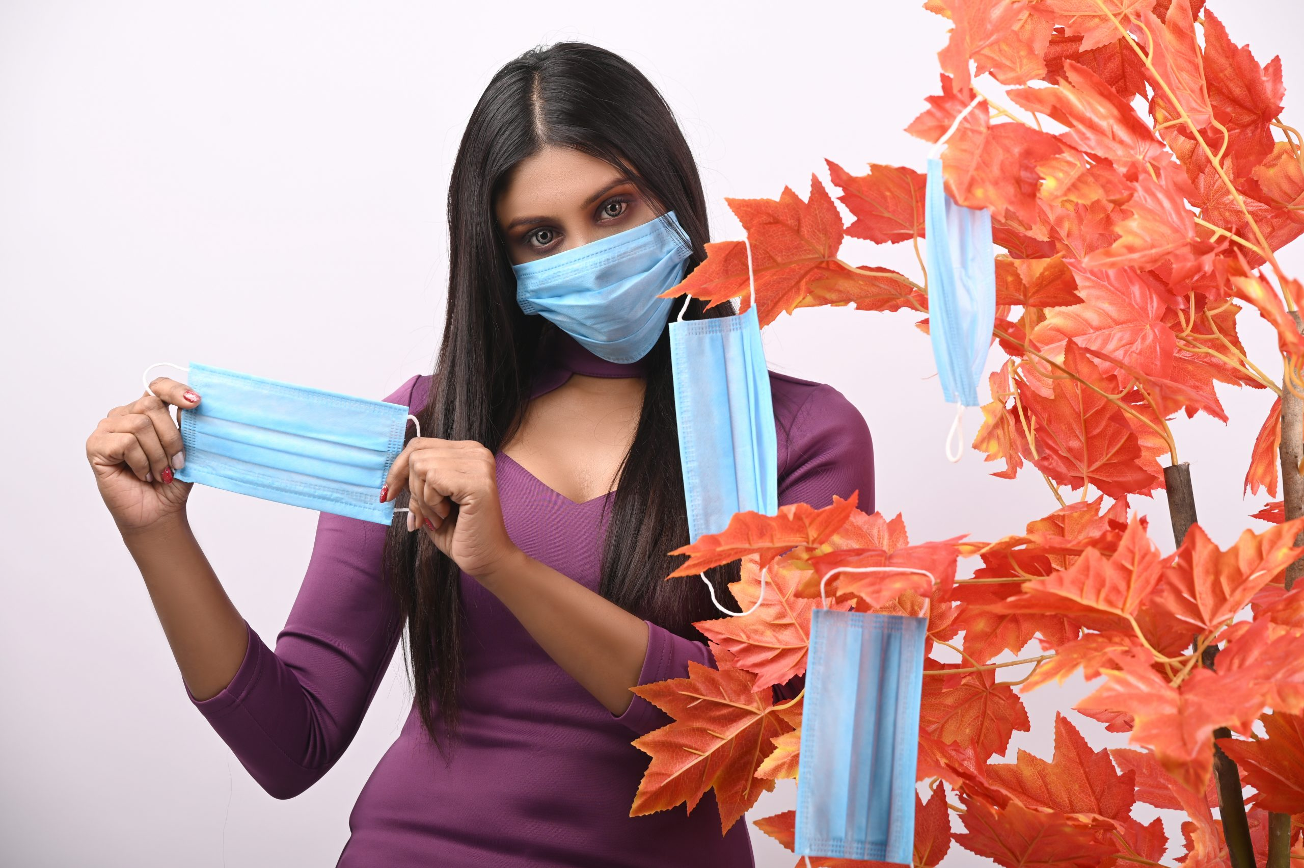 Model posing with mask