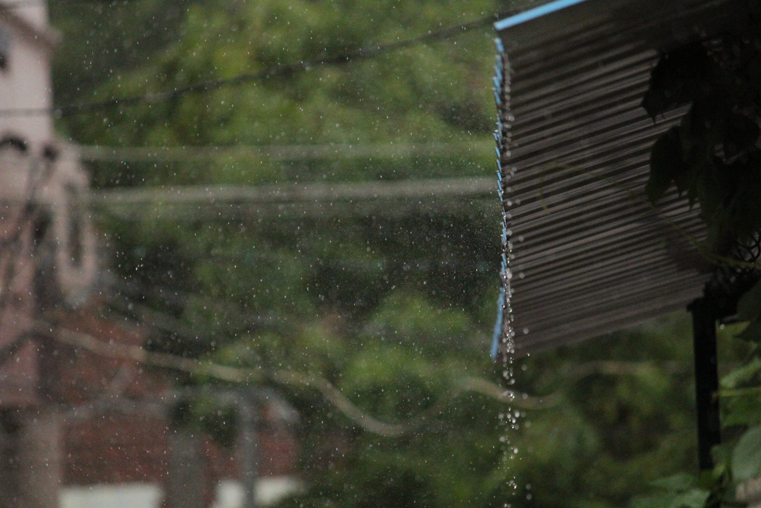 Rain water falling down from a shed