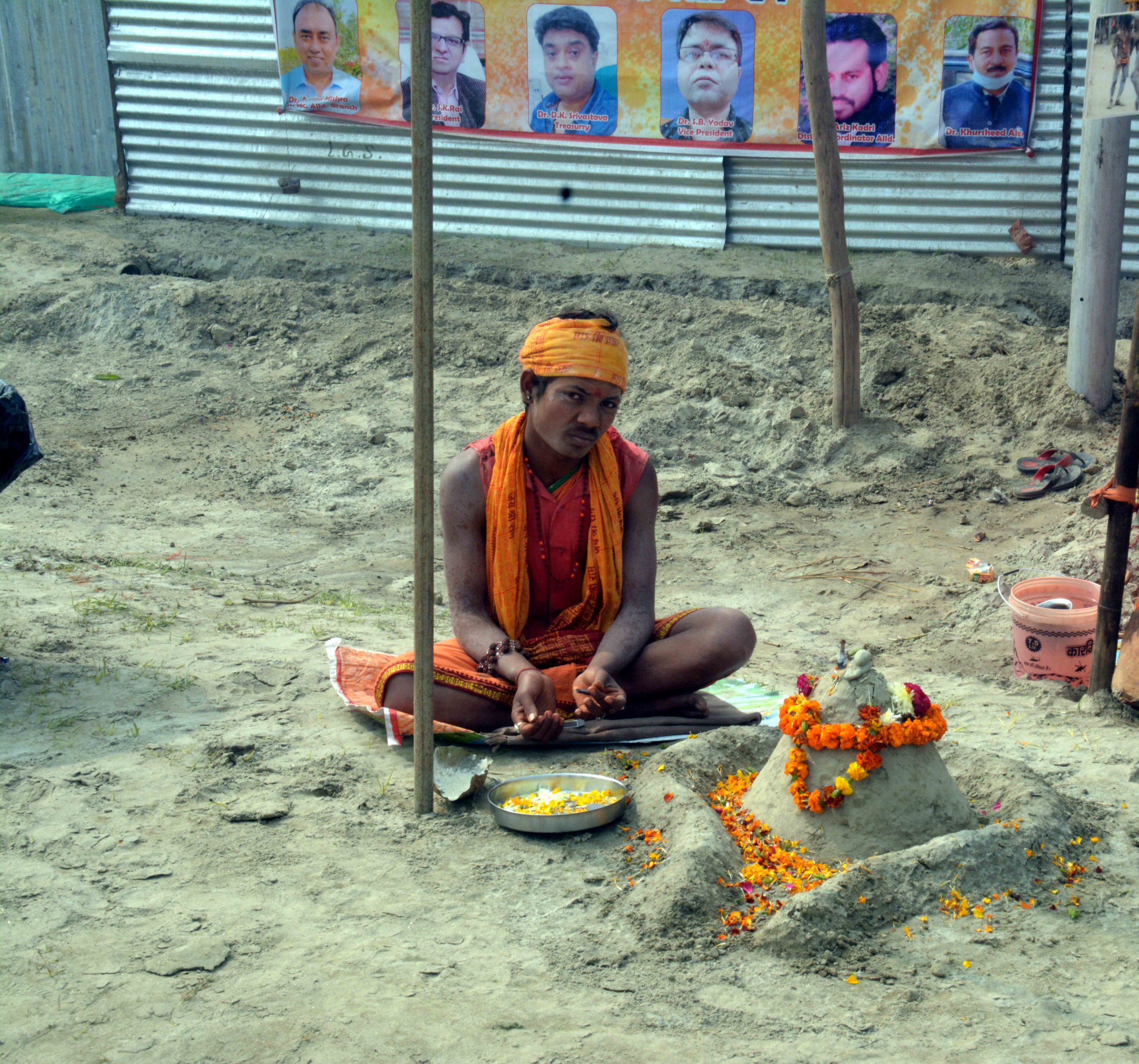 A monk worshipping lord Shiva