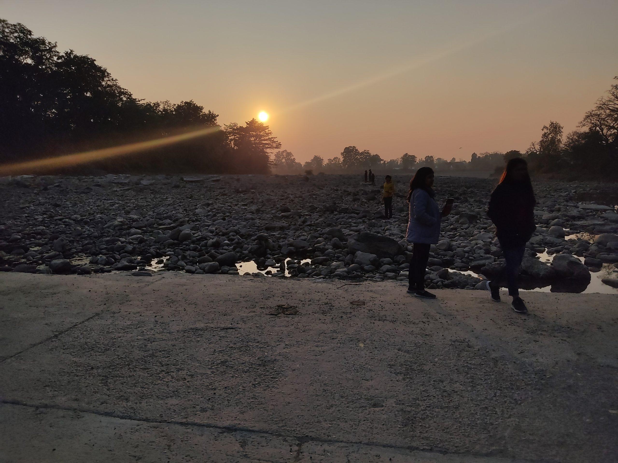 Tourists and sunset