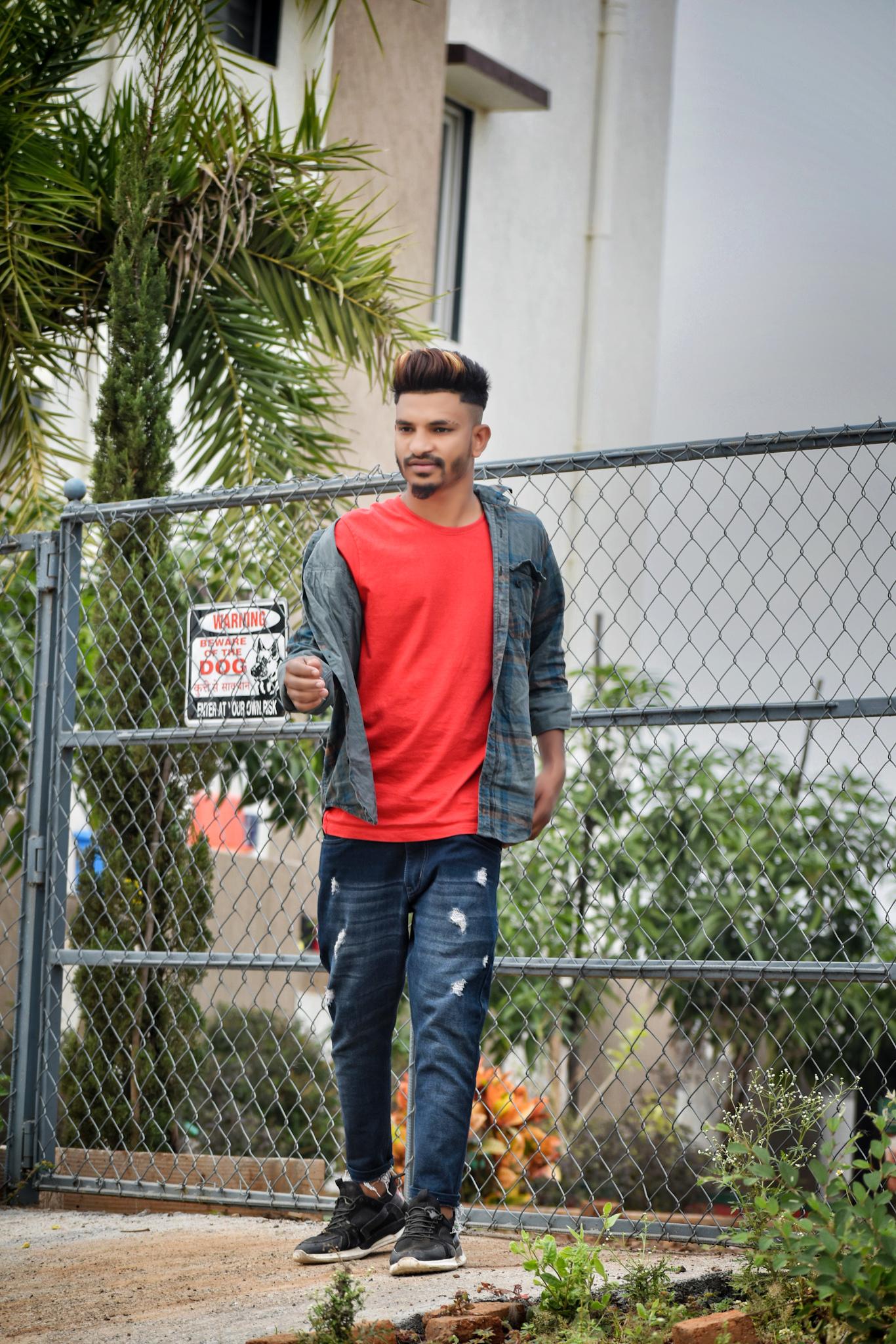 Boy posing in front steel gate
