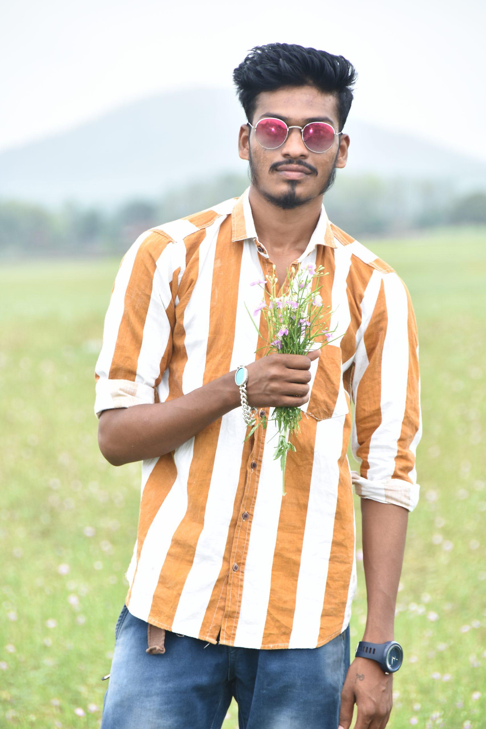 Boy posing with wild flowers