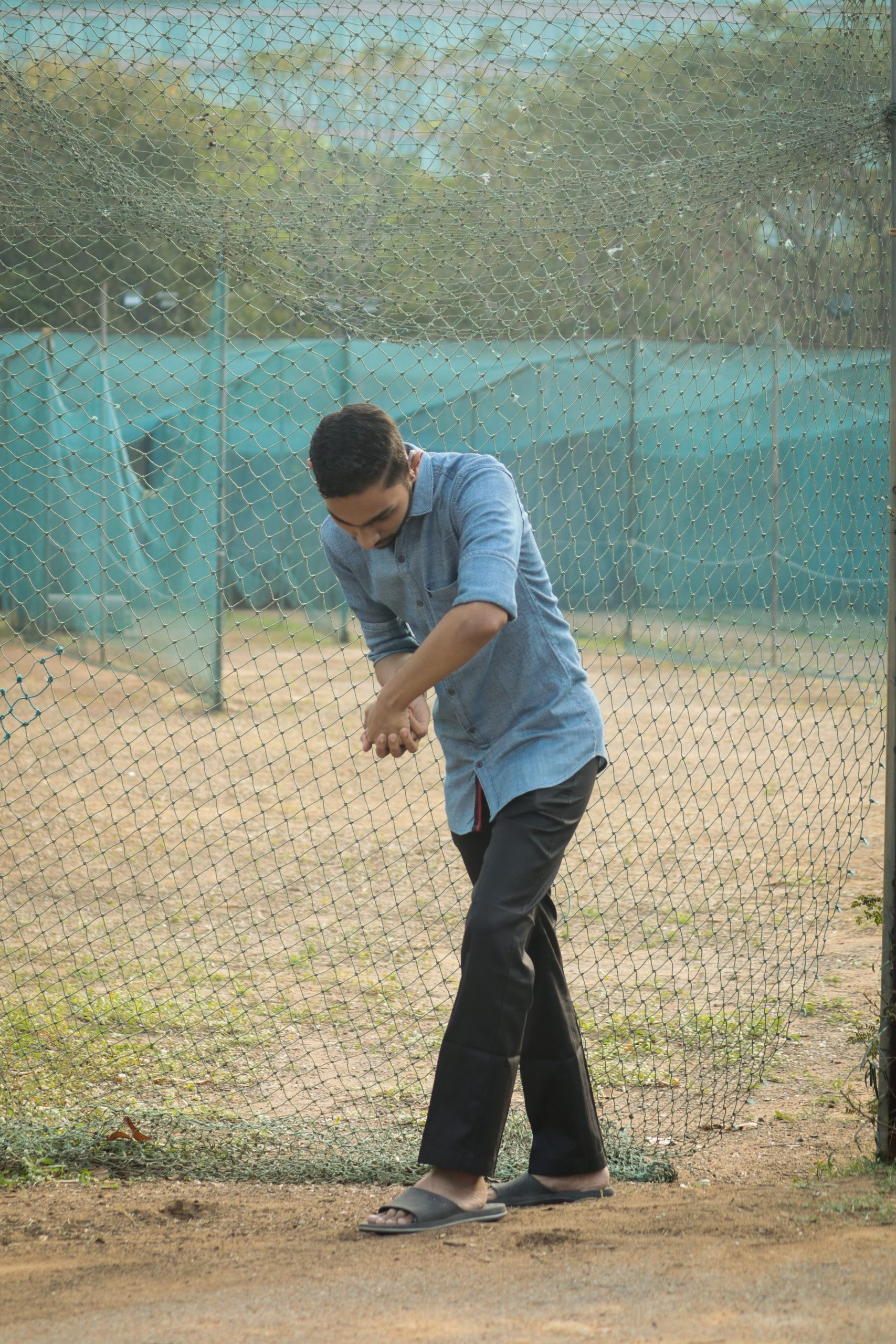 A boy acting to play a cricket shot