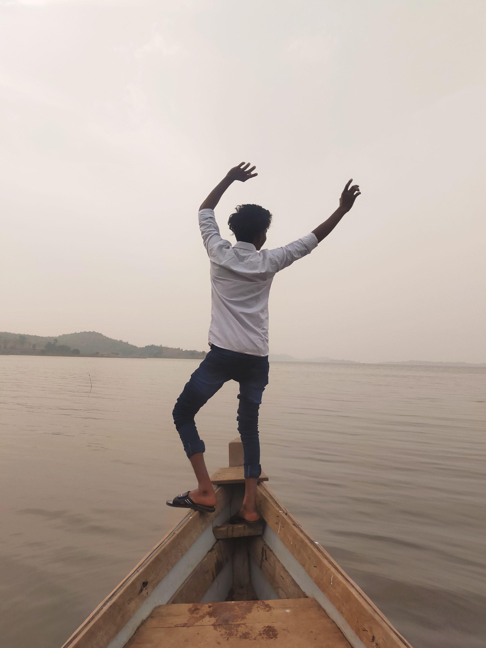 A boy enjoying at a boat