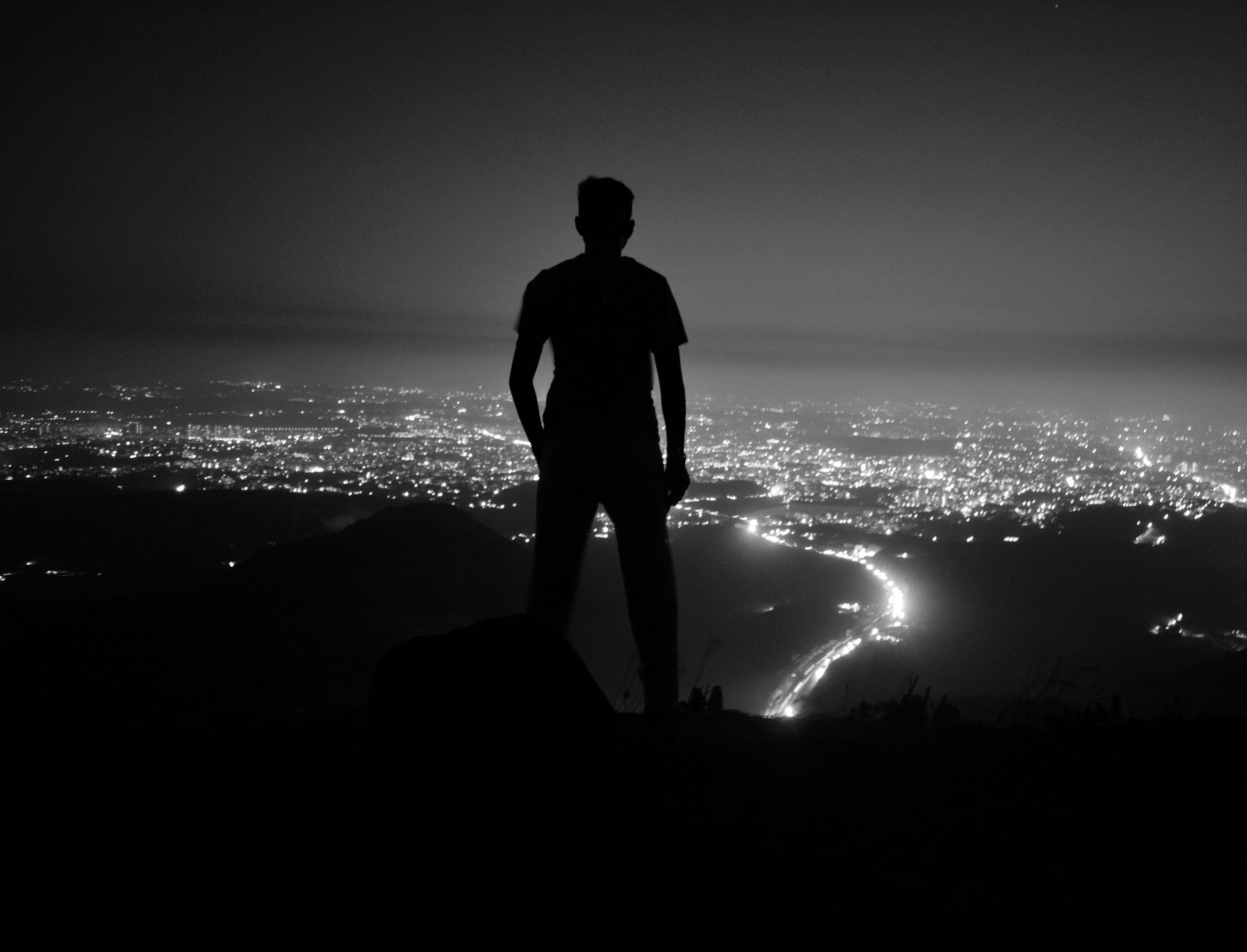 A boy enjoying night view of a city