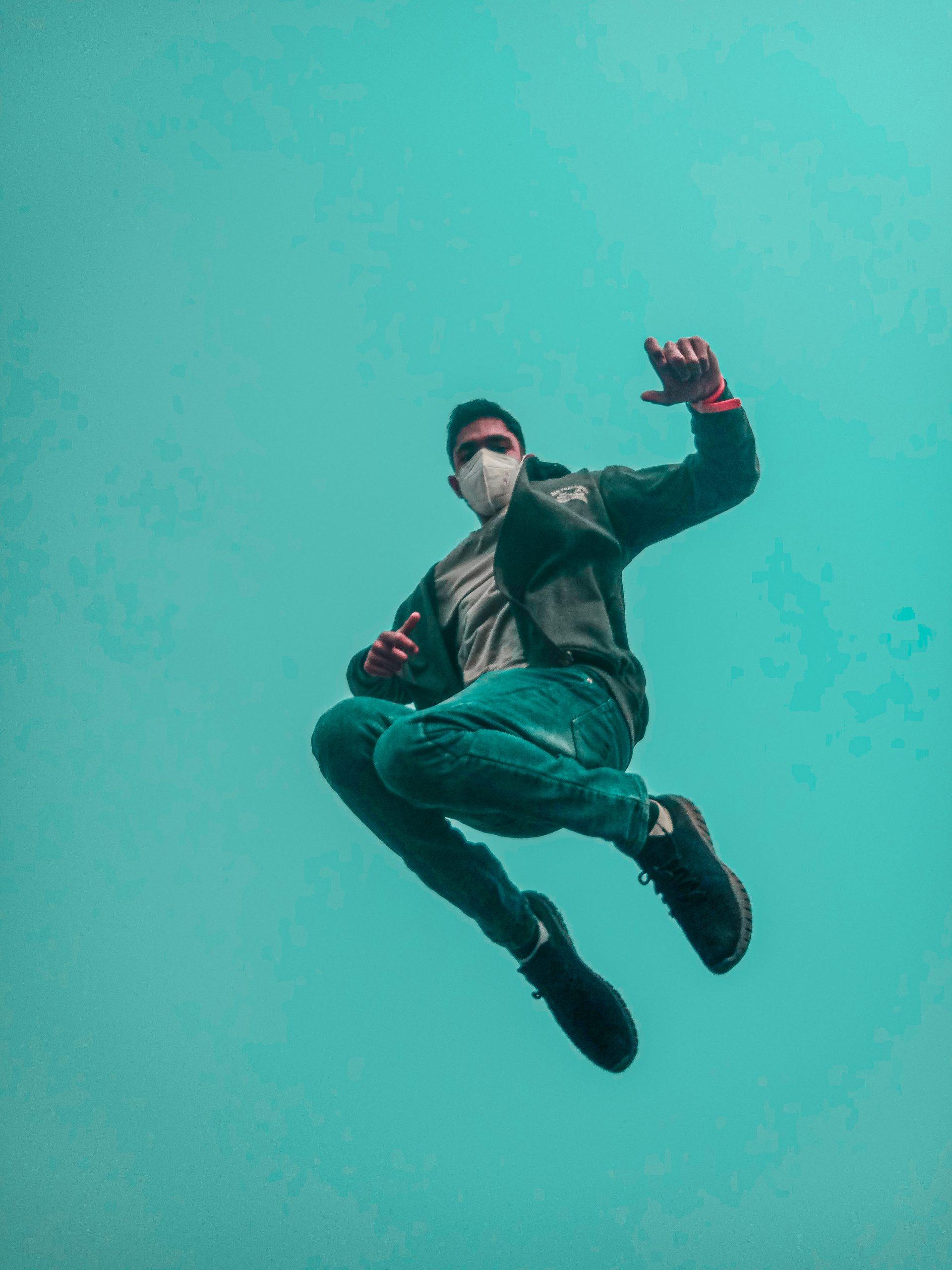 A boy jumping in air