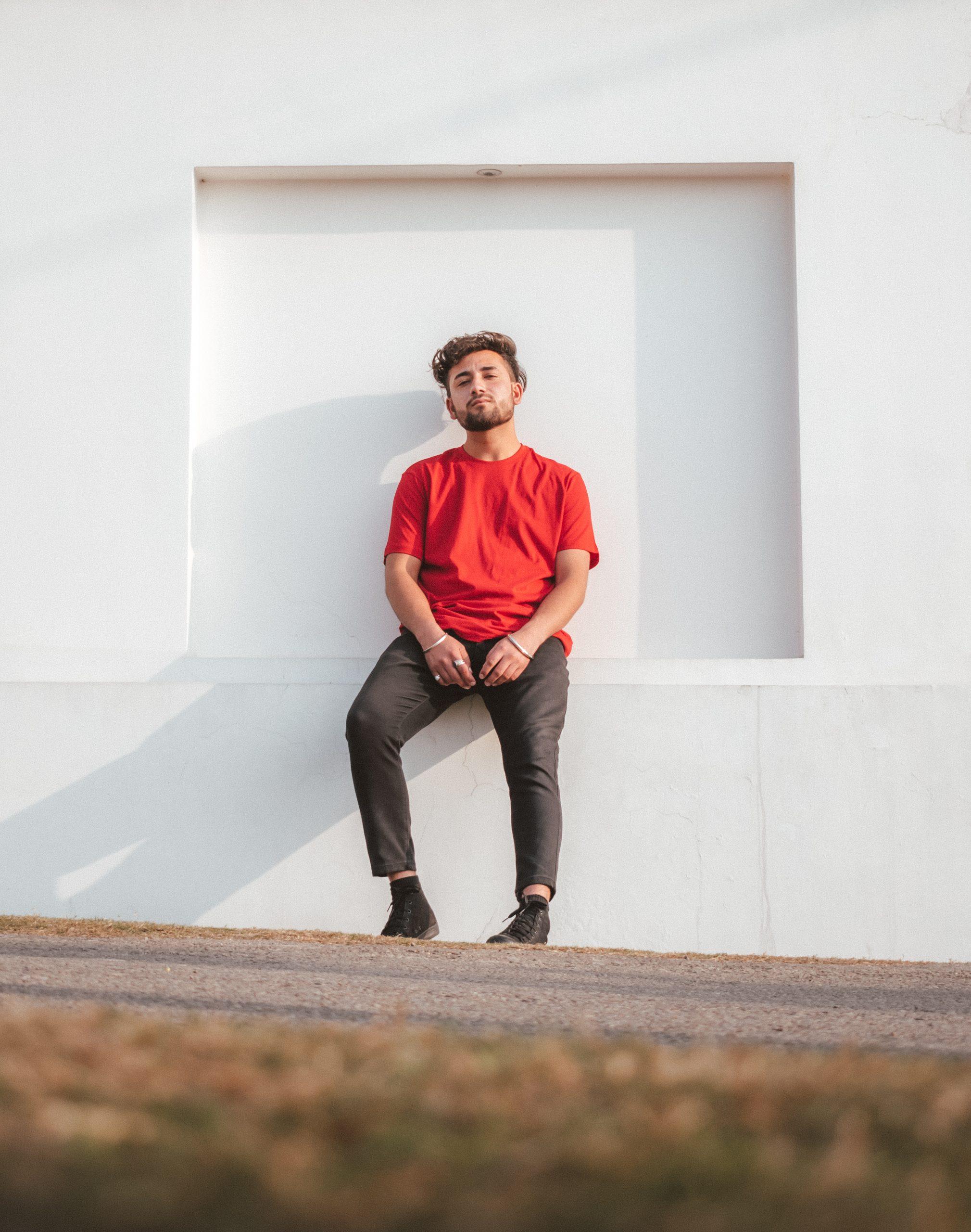 A boy near a wall