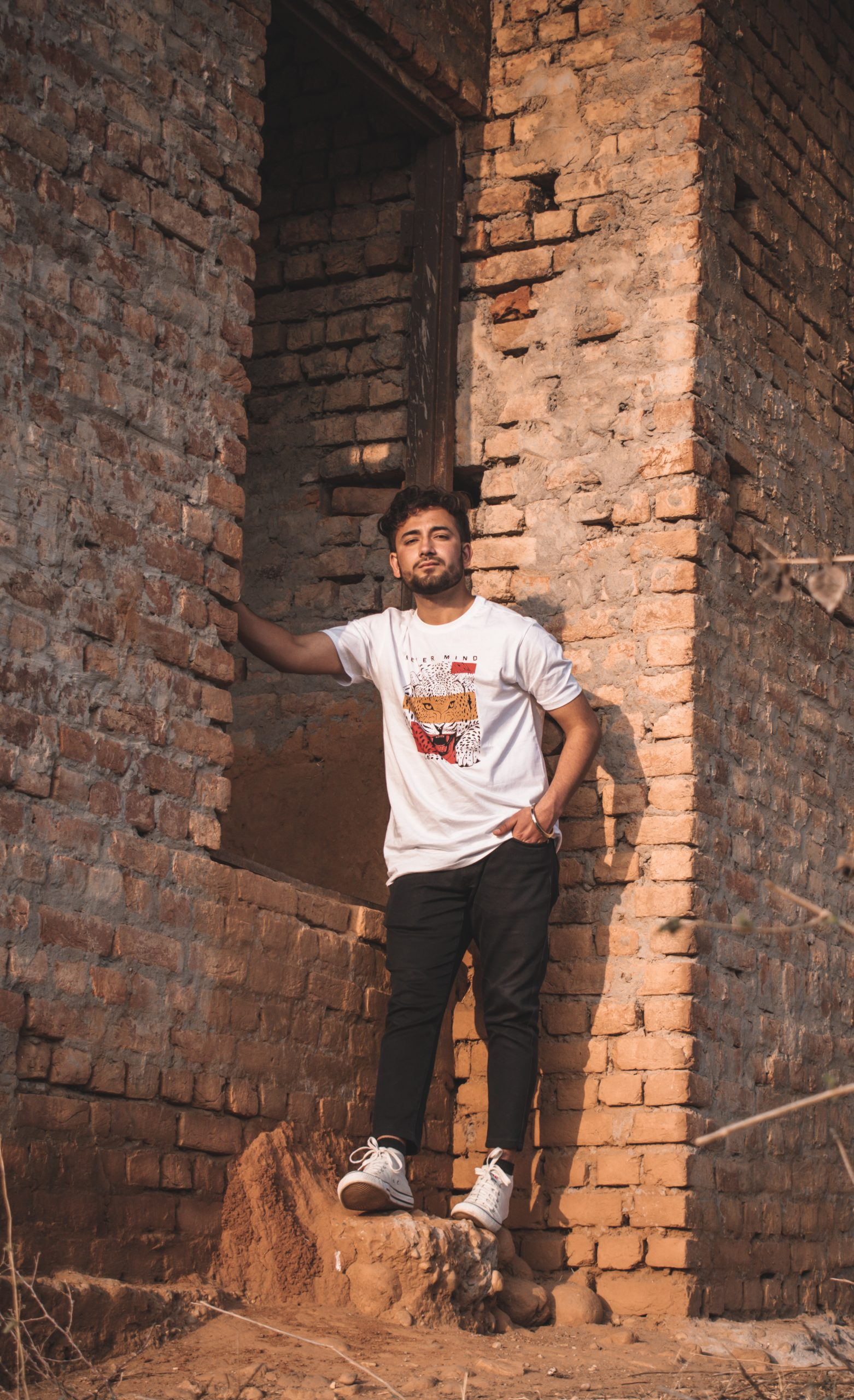 A boy near a brick wall