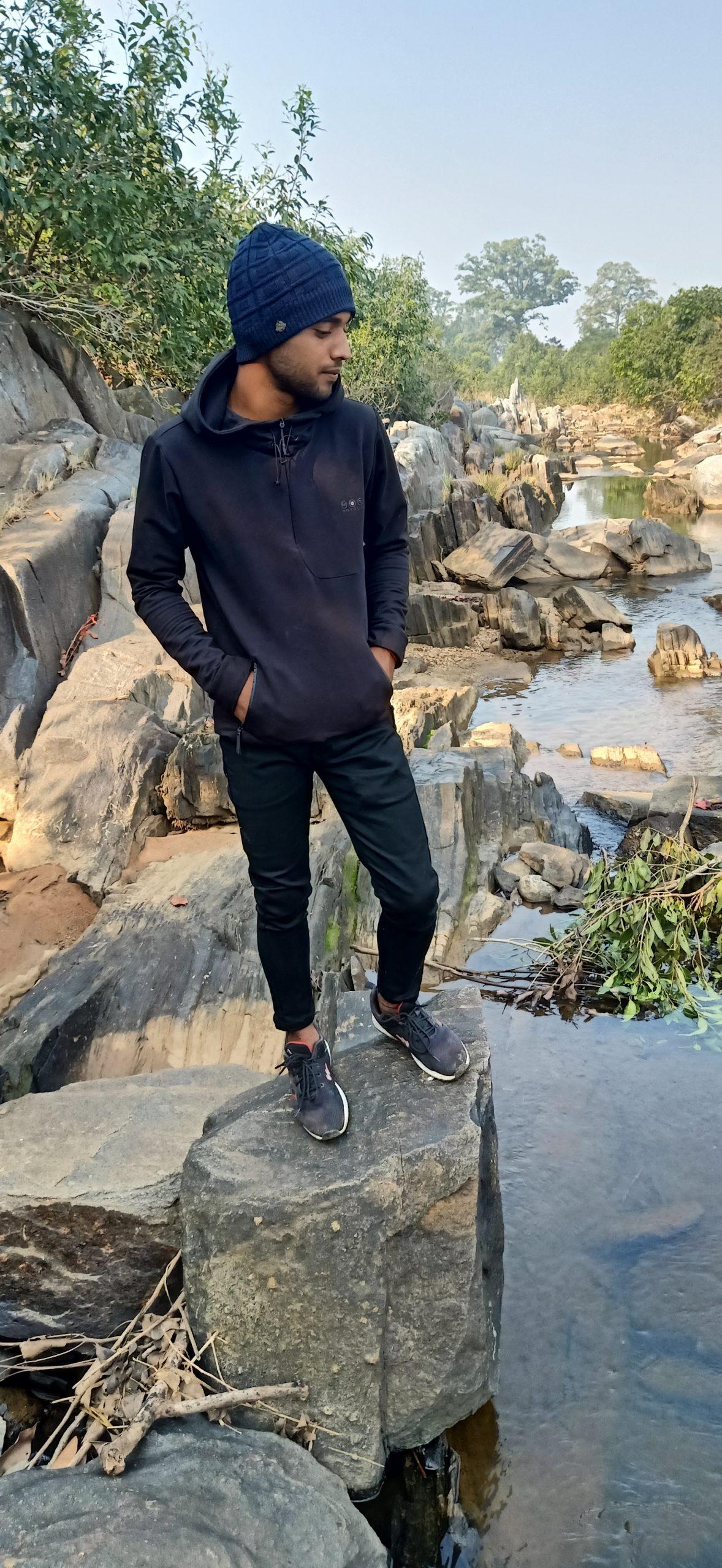 A boy on a rock