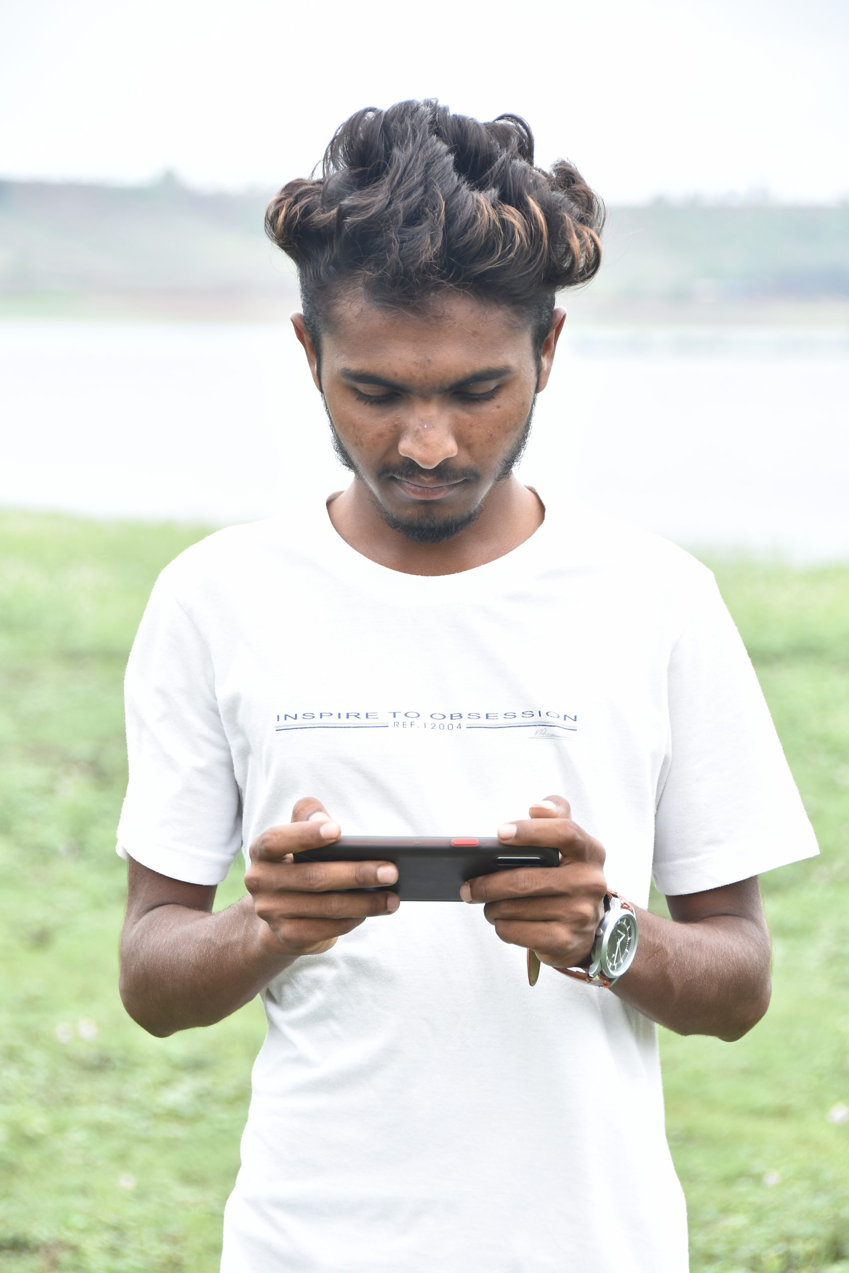 A boy playing mobile game
