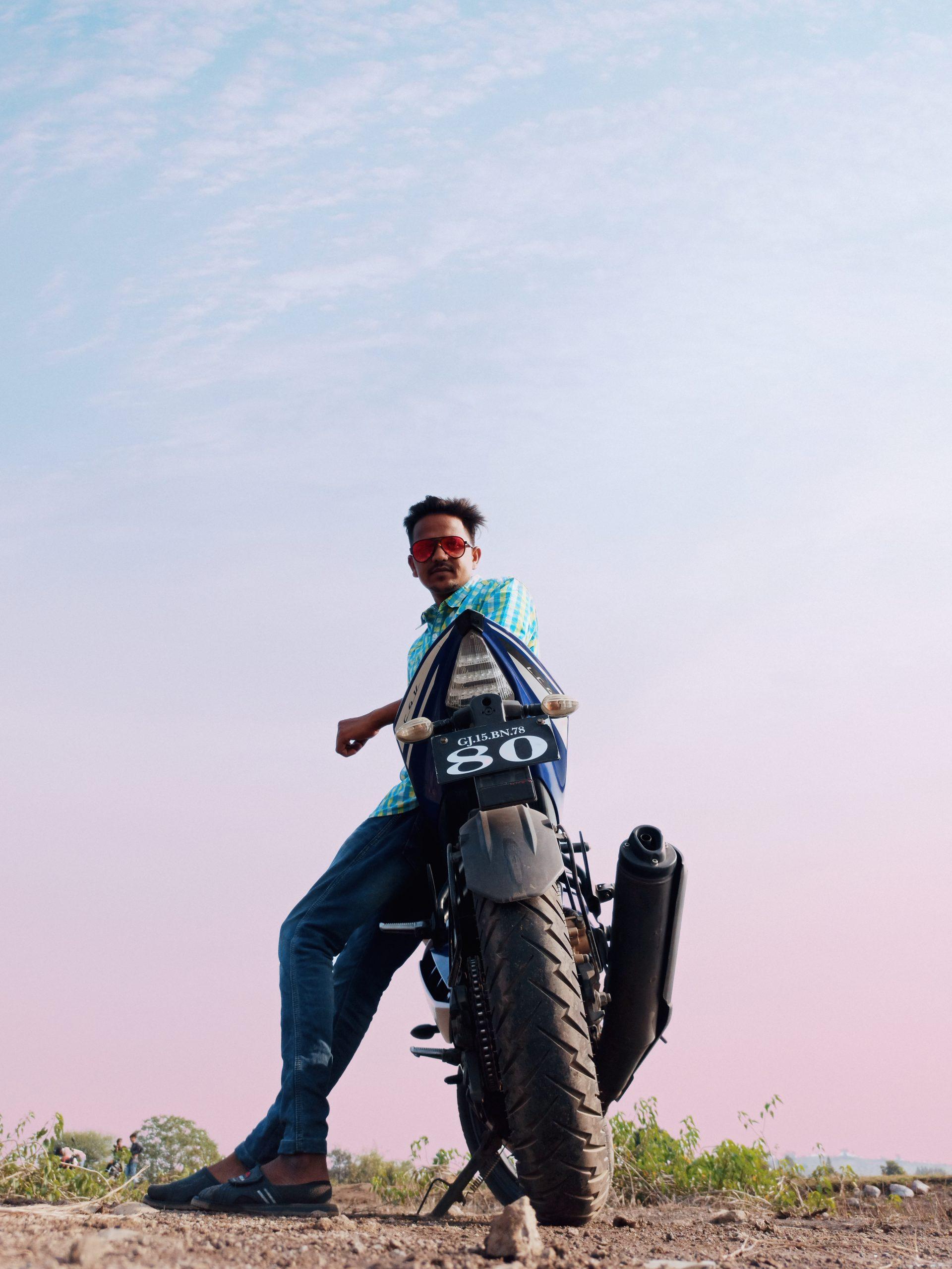 A boy posing on bike