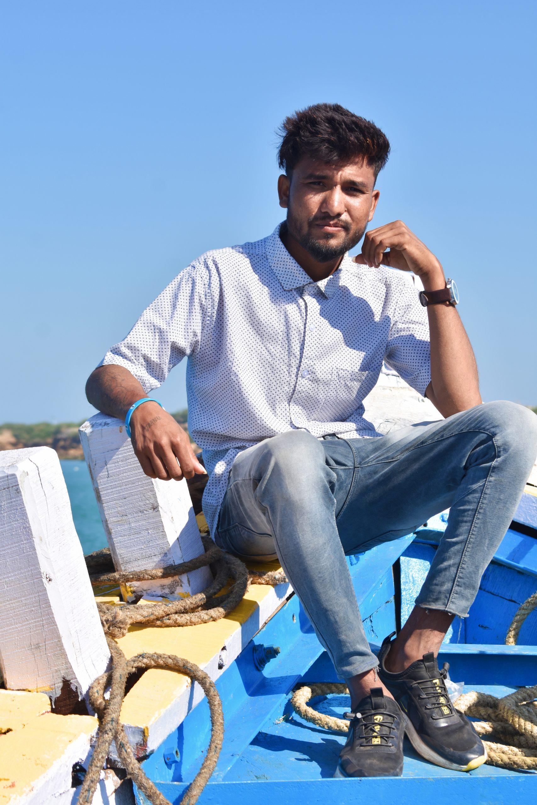 A boy sitting on a boat