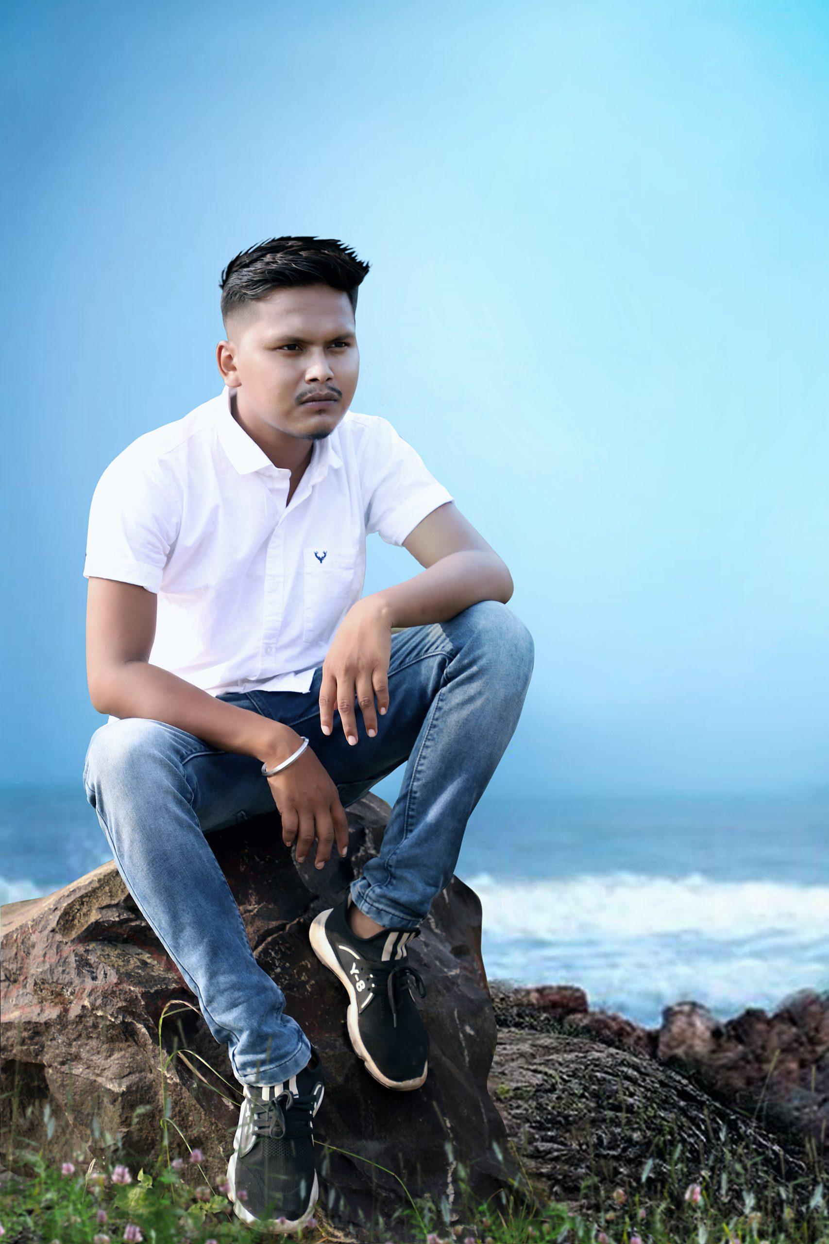 A boy sitting on a rock