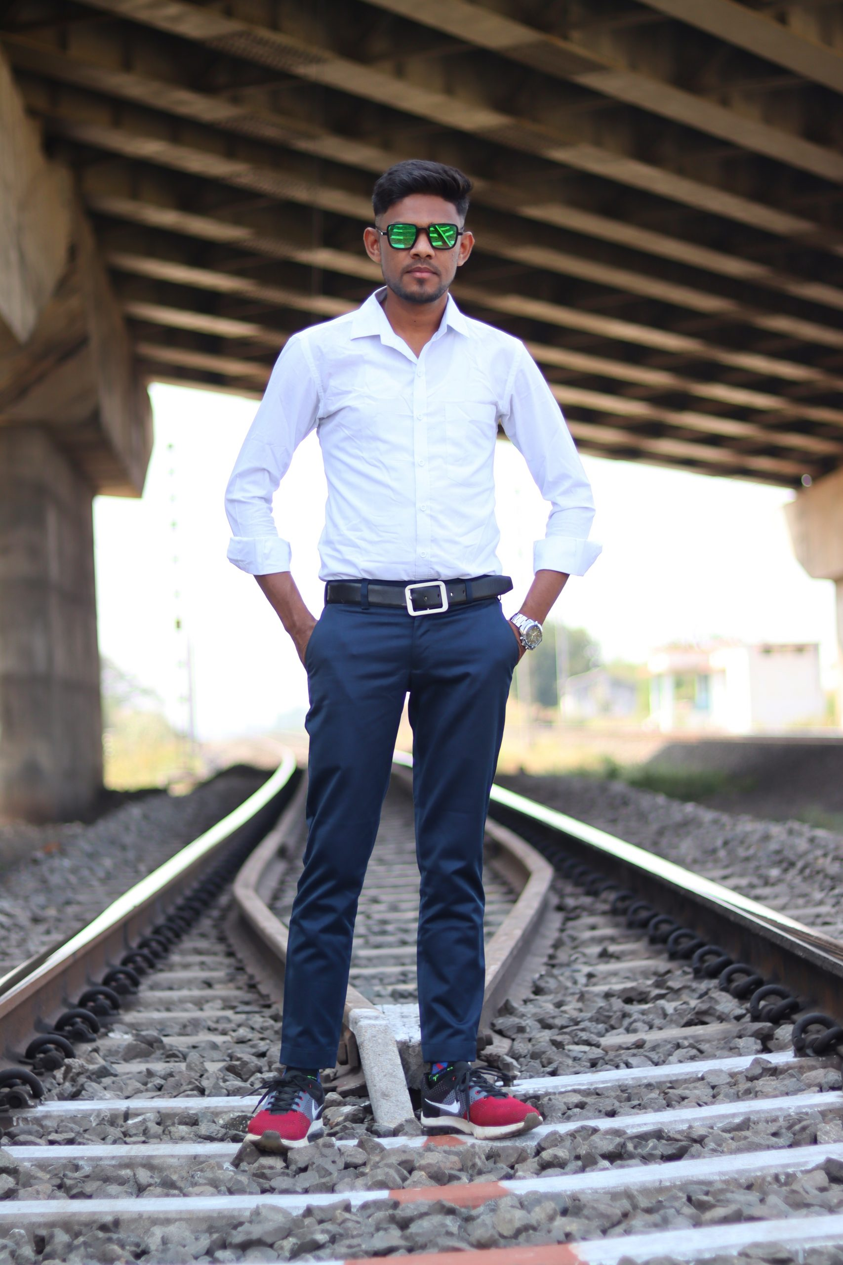 A boy standing on railway track