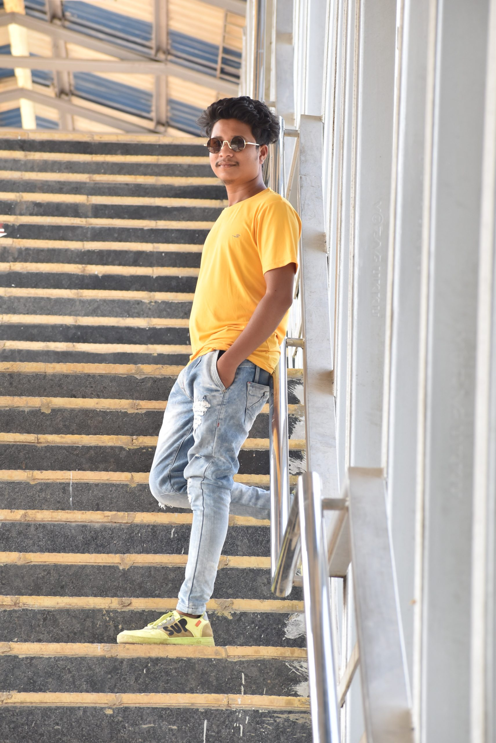 A boy standing on stairs