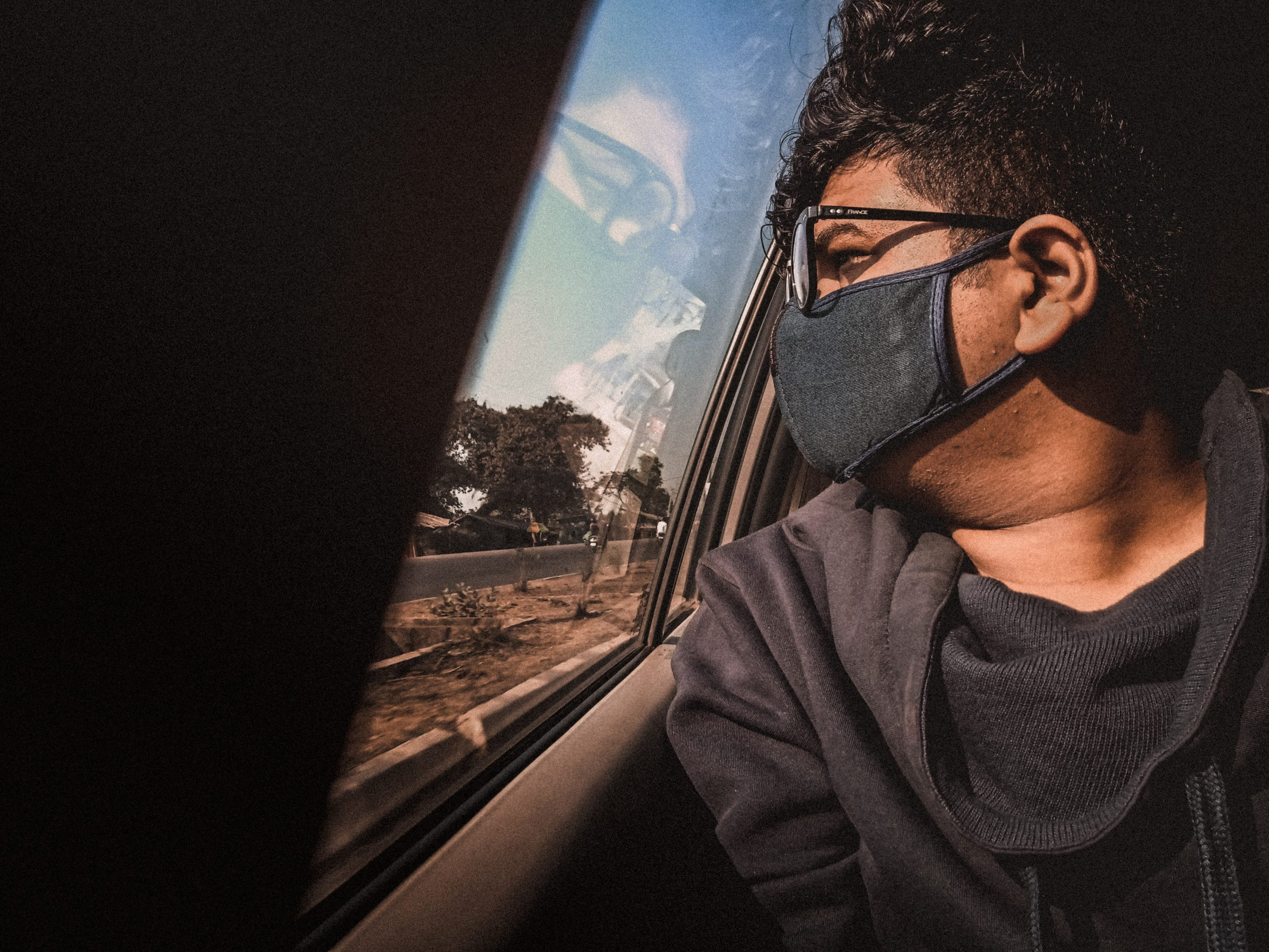 A boy through car window