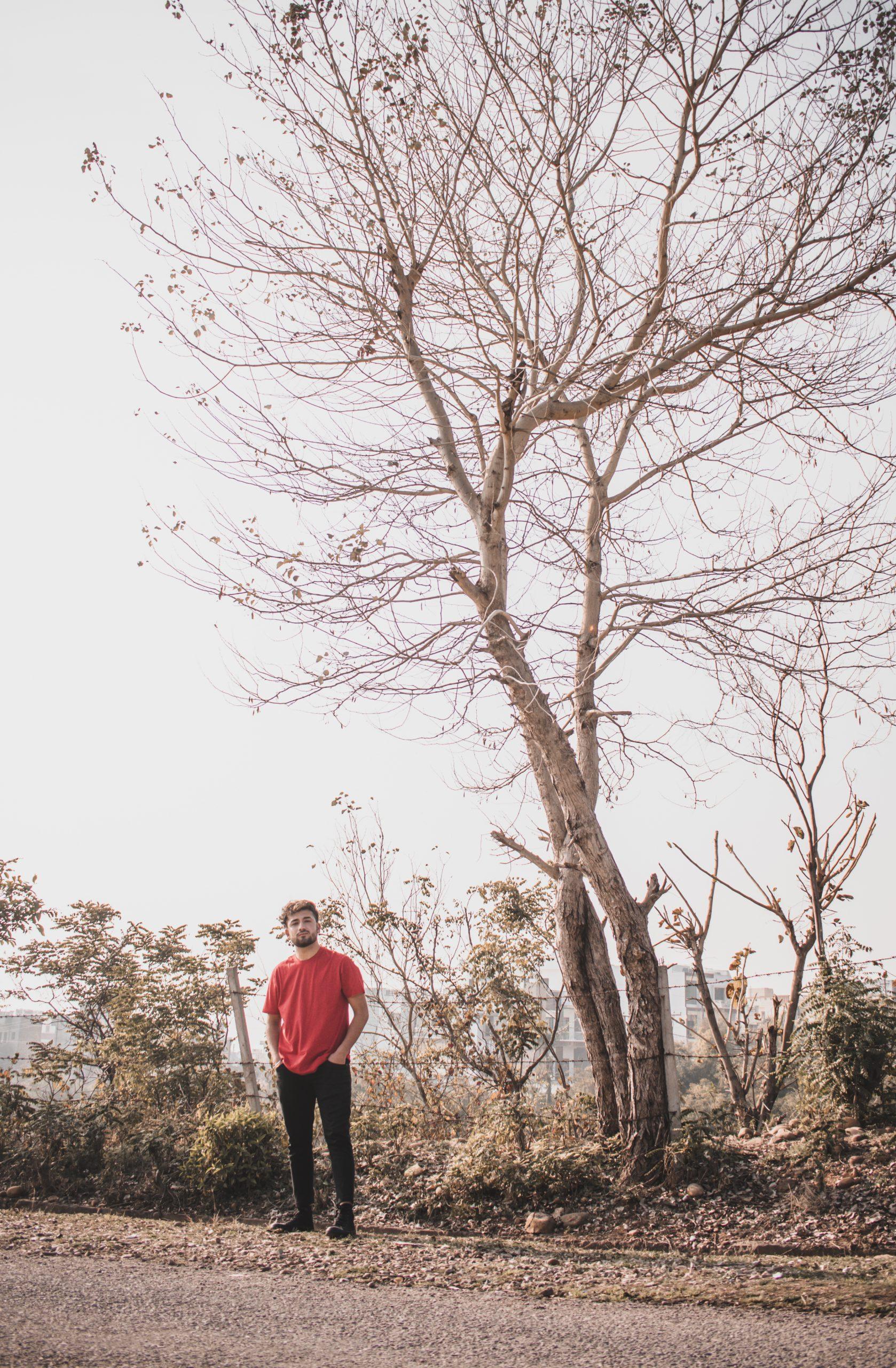 A boy under a tree