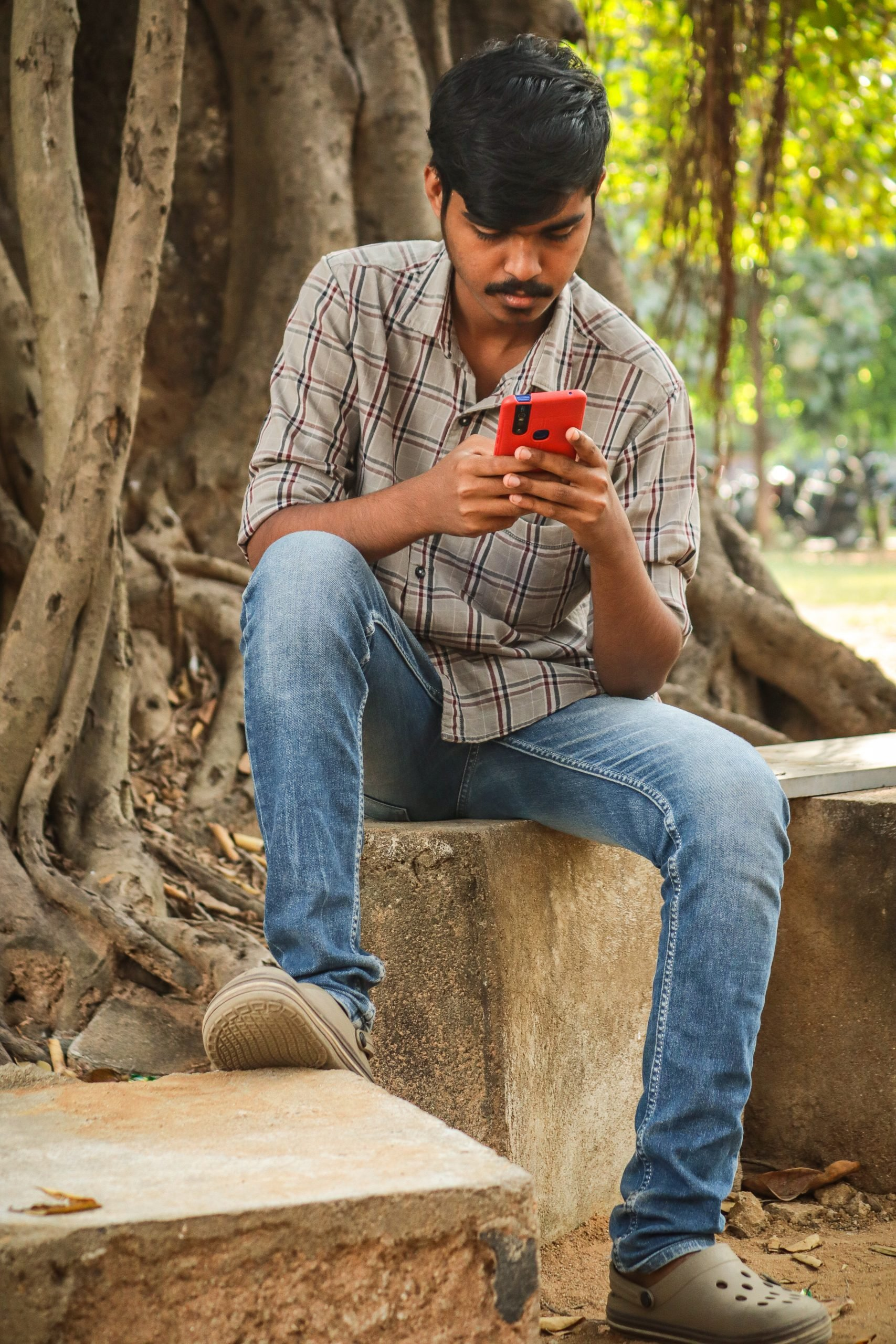A boy using a smartphone