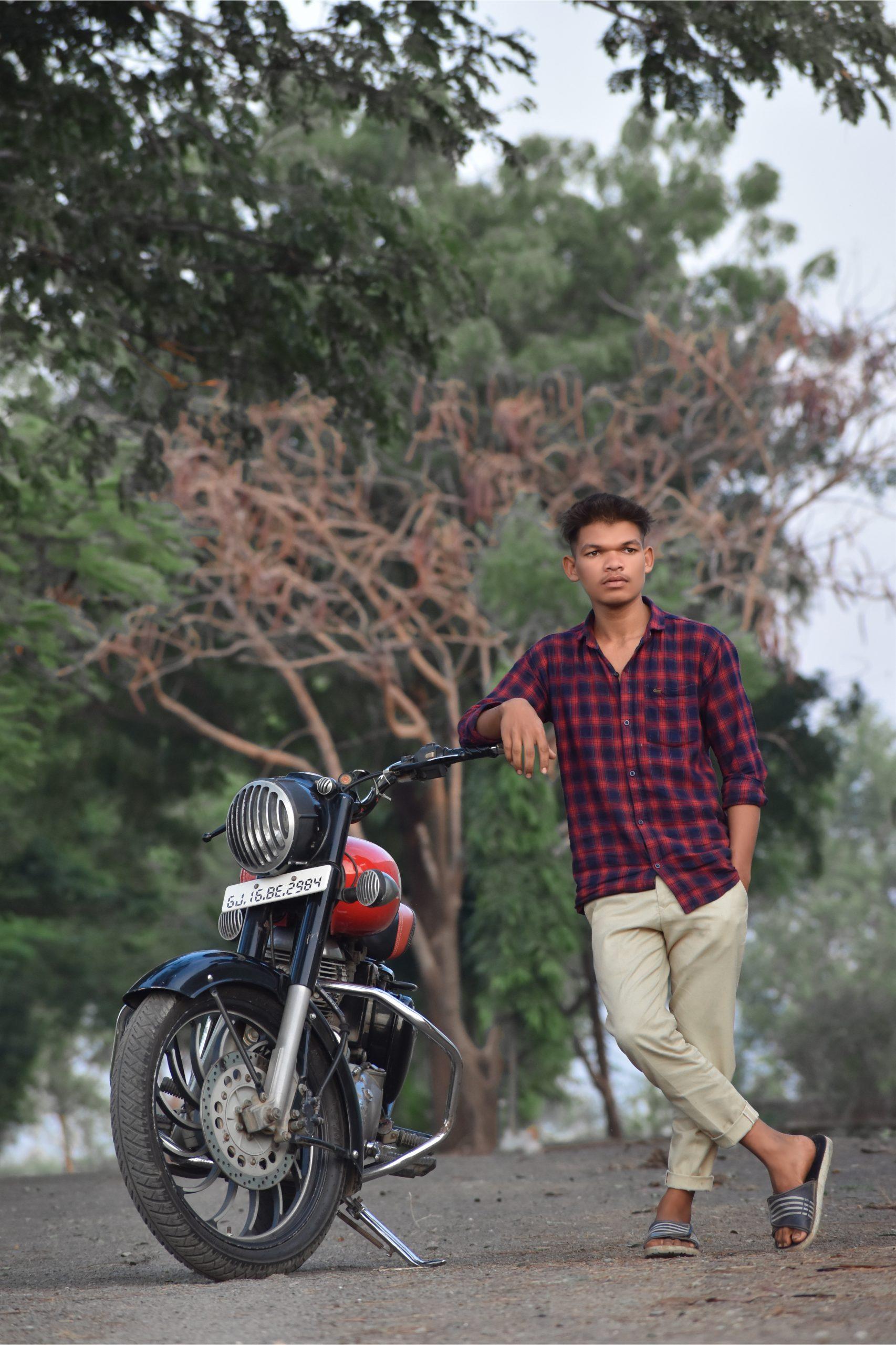 A boy with a bike