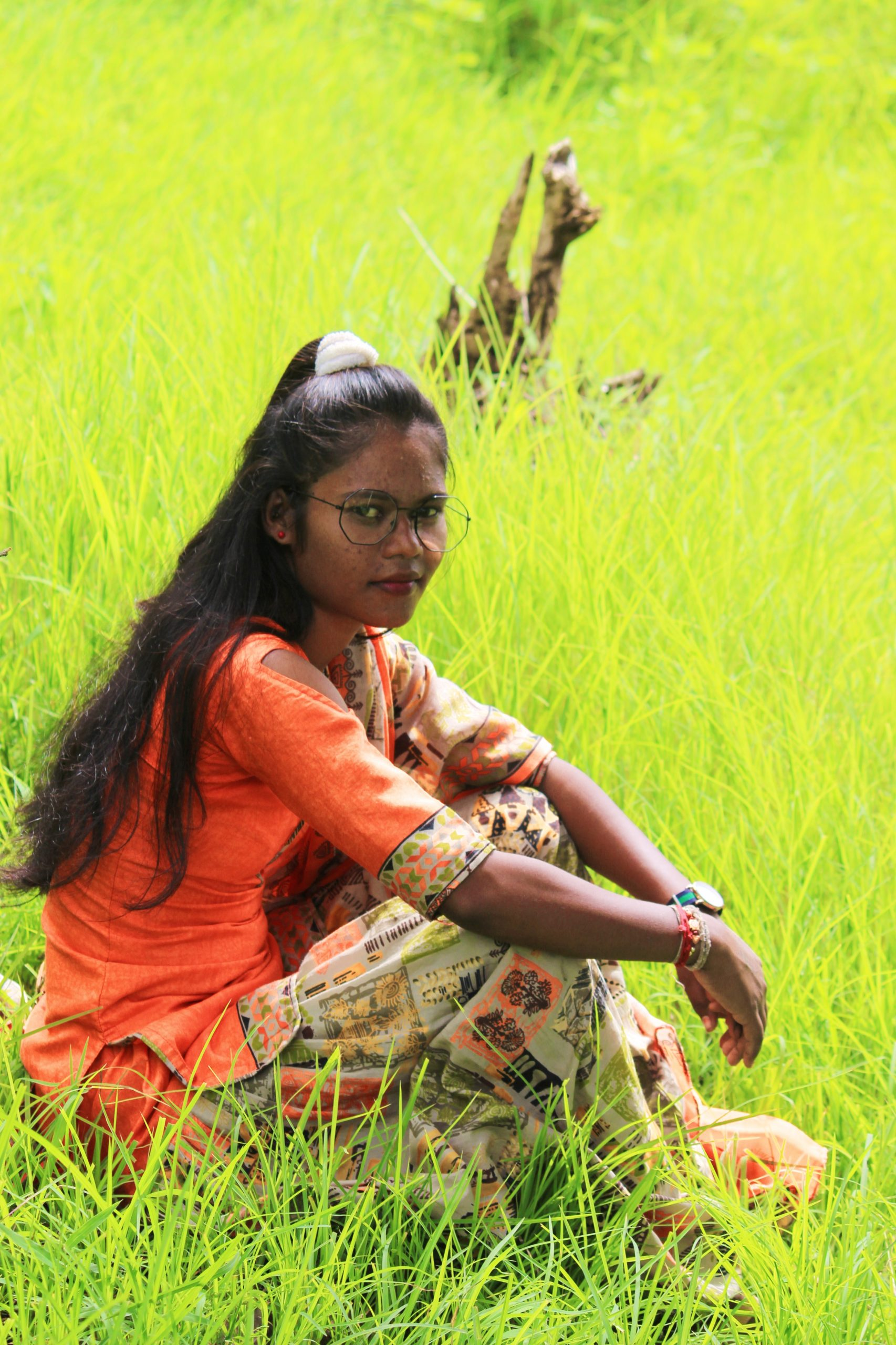 A girl sitting on grass