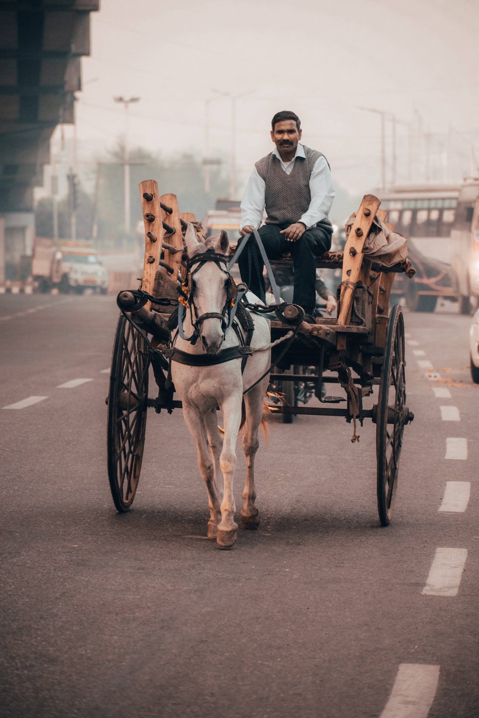 A man on horse cart